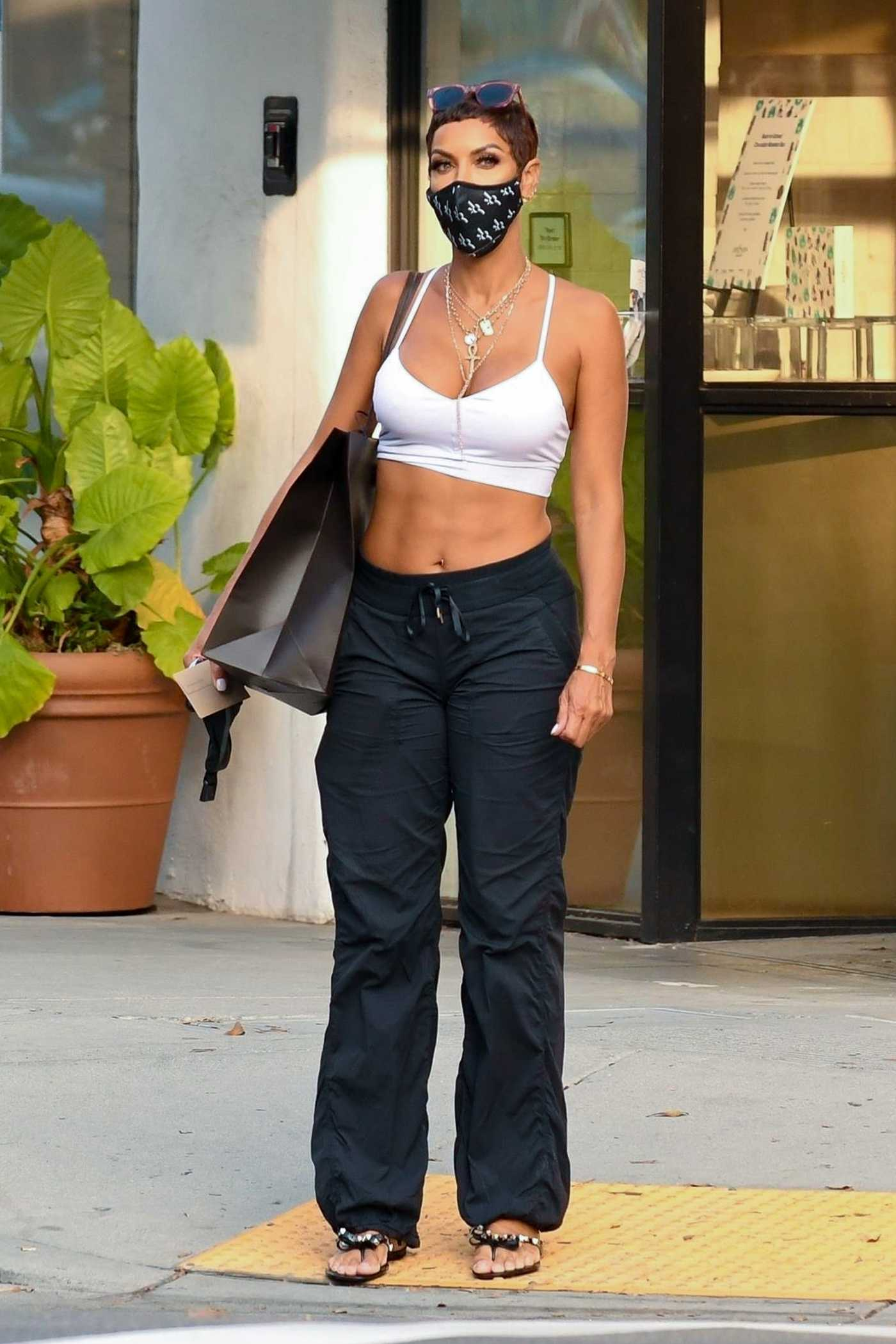 Nicole Murphy in a White Bra Was Spotted on Rodeo Drive in Beverly Hills 10/05/2020