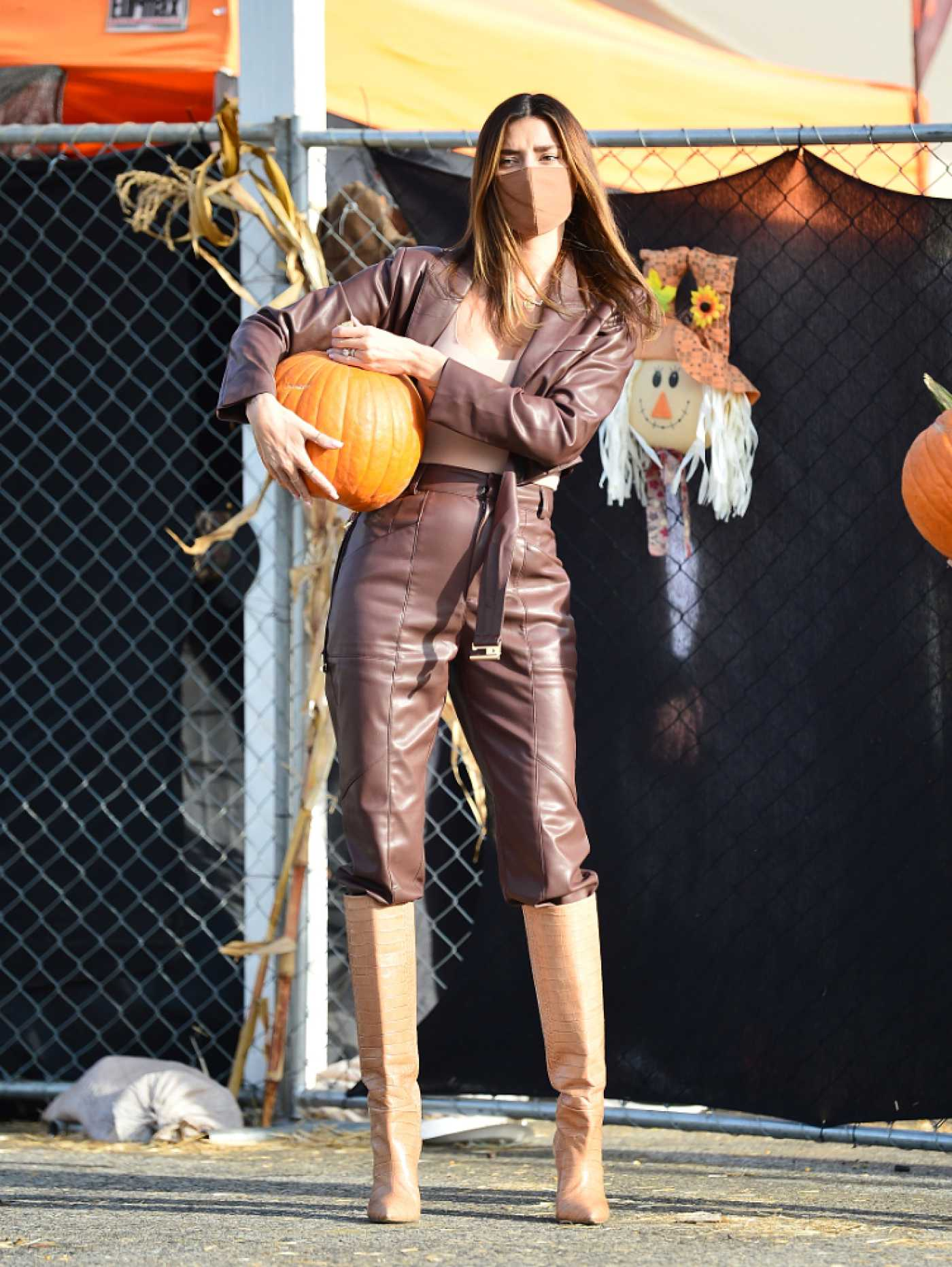Nicole Williams in a Brown Leather Suit Stops by the Pumpkin Patch Out with Larry English in Los Angeles 10/26/2020