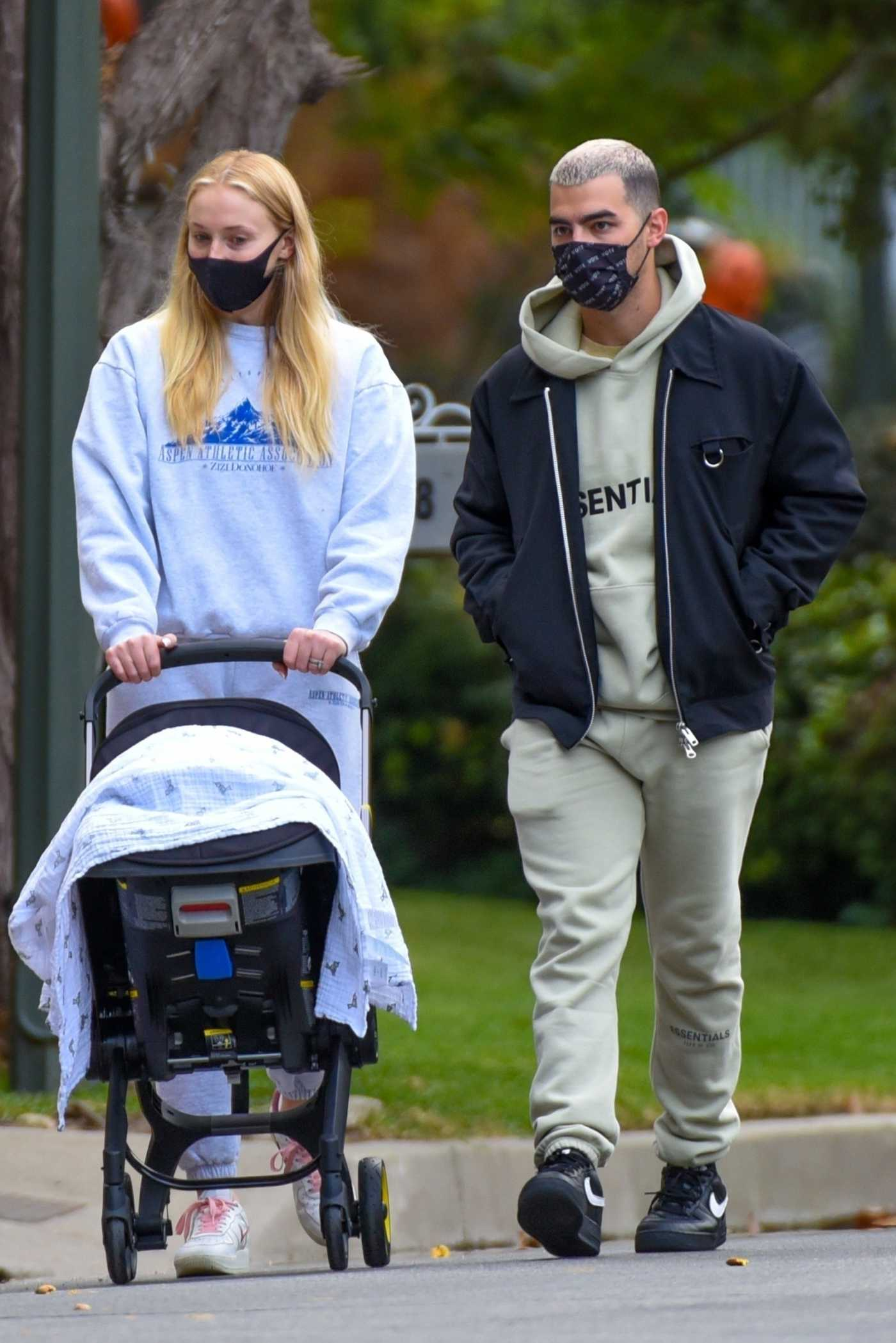 Sophie Turner in a Grey Sweatsuit Takes a Walk with Her New Baby Willa Out with Joe Jonas in Los Angeles 10/25/2020