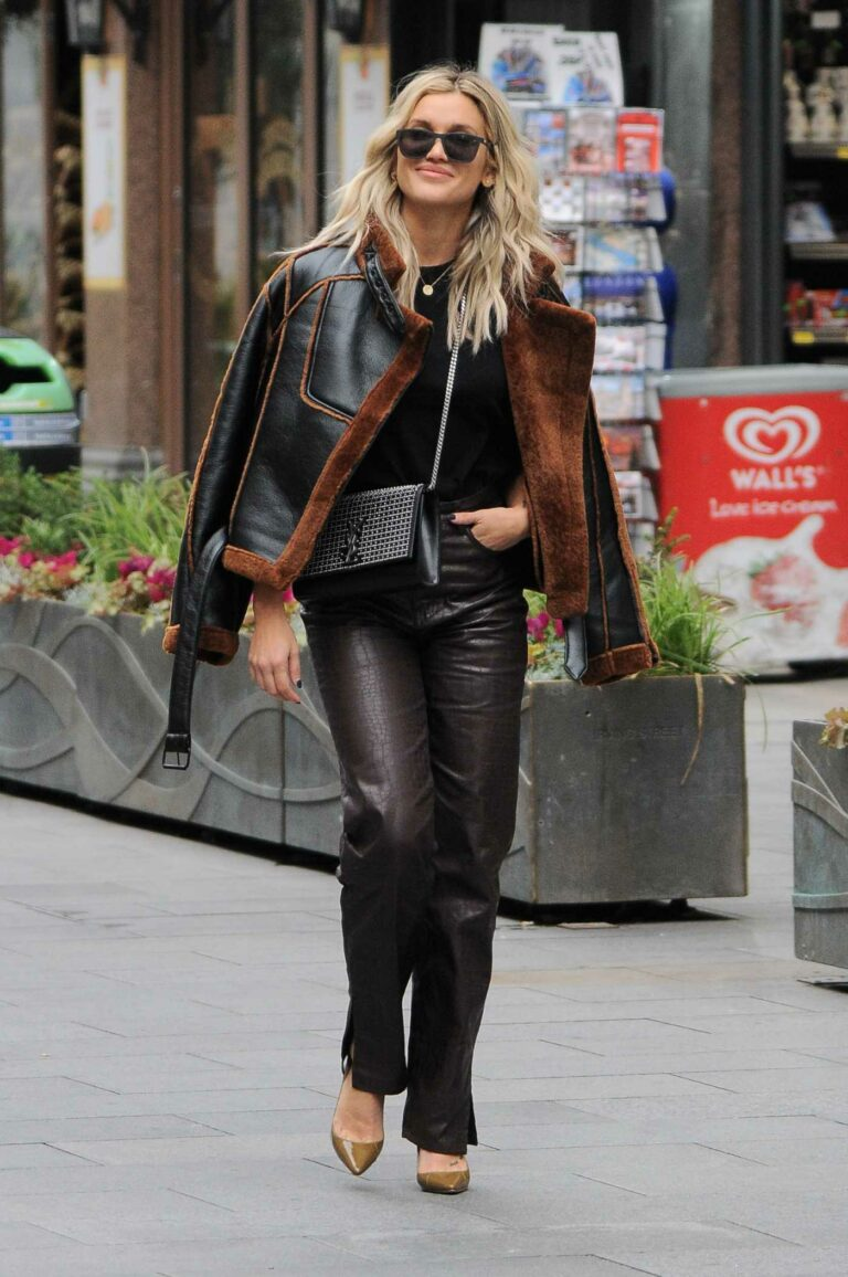 Ashley Roberts in a Brown Snakeskin Print Pants