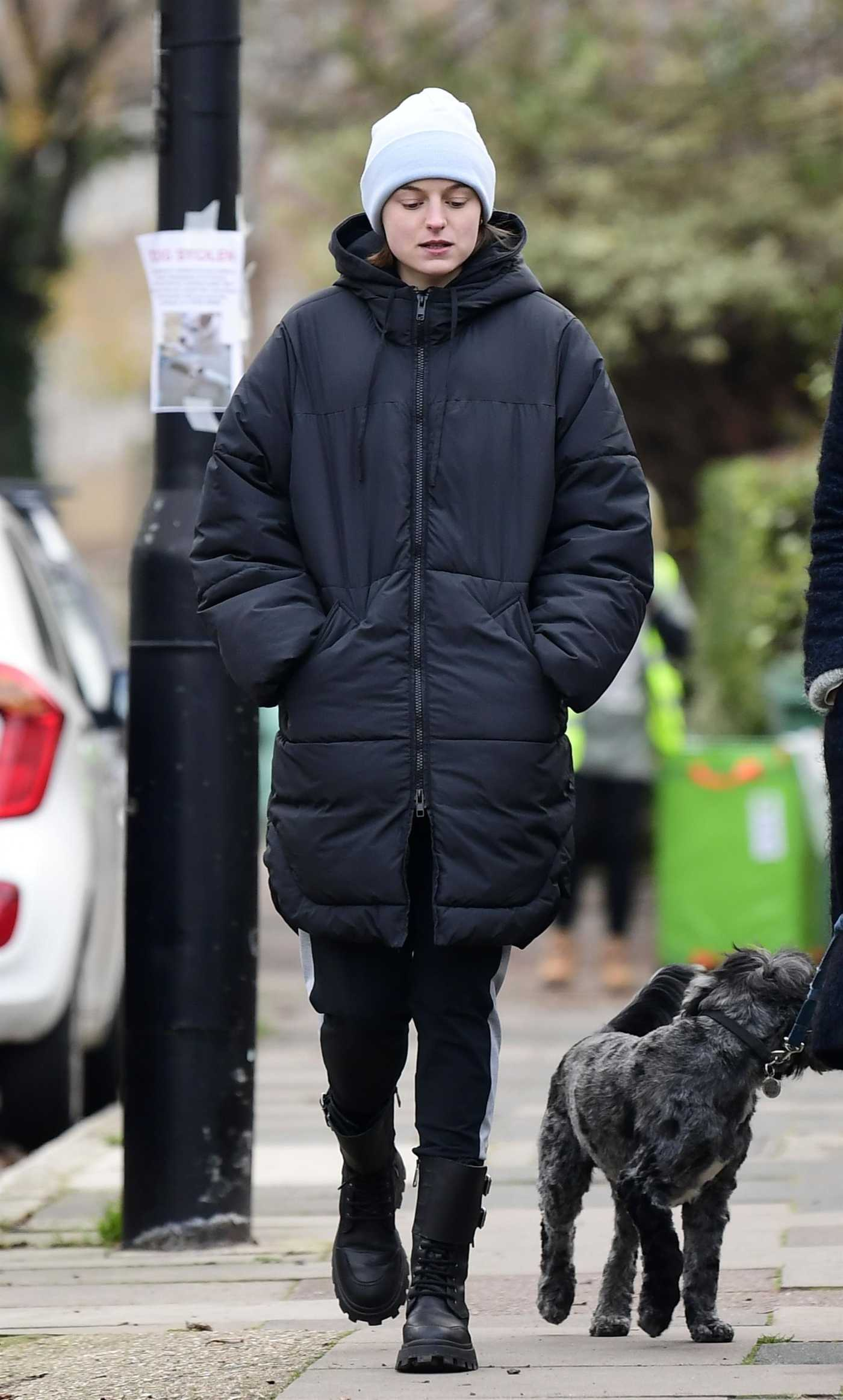 Emma Corrin in a White Beanie Hat Enjoys a Stroll in Belsize Park in North London 11/26/2020