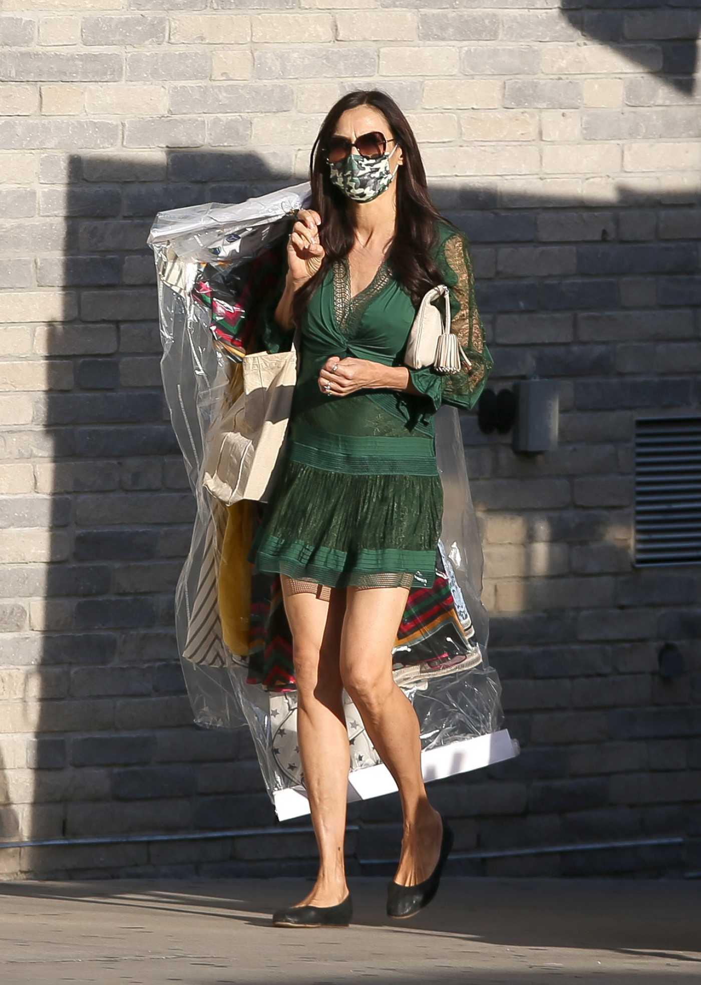 Famke Janssen in a Green Mini Dress Was Seen Out in New York 11/05/2020