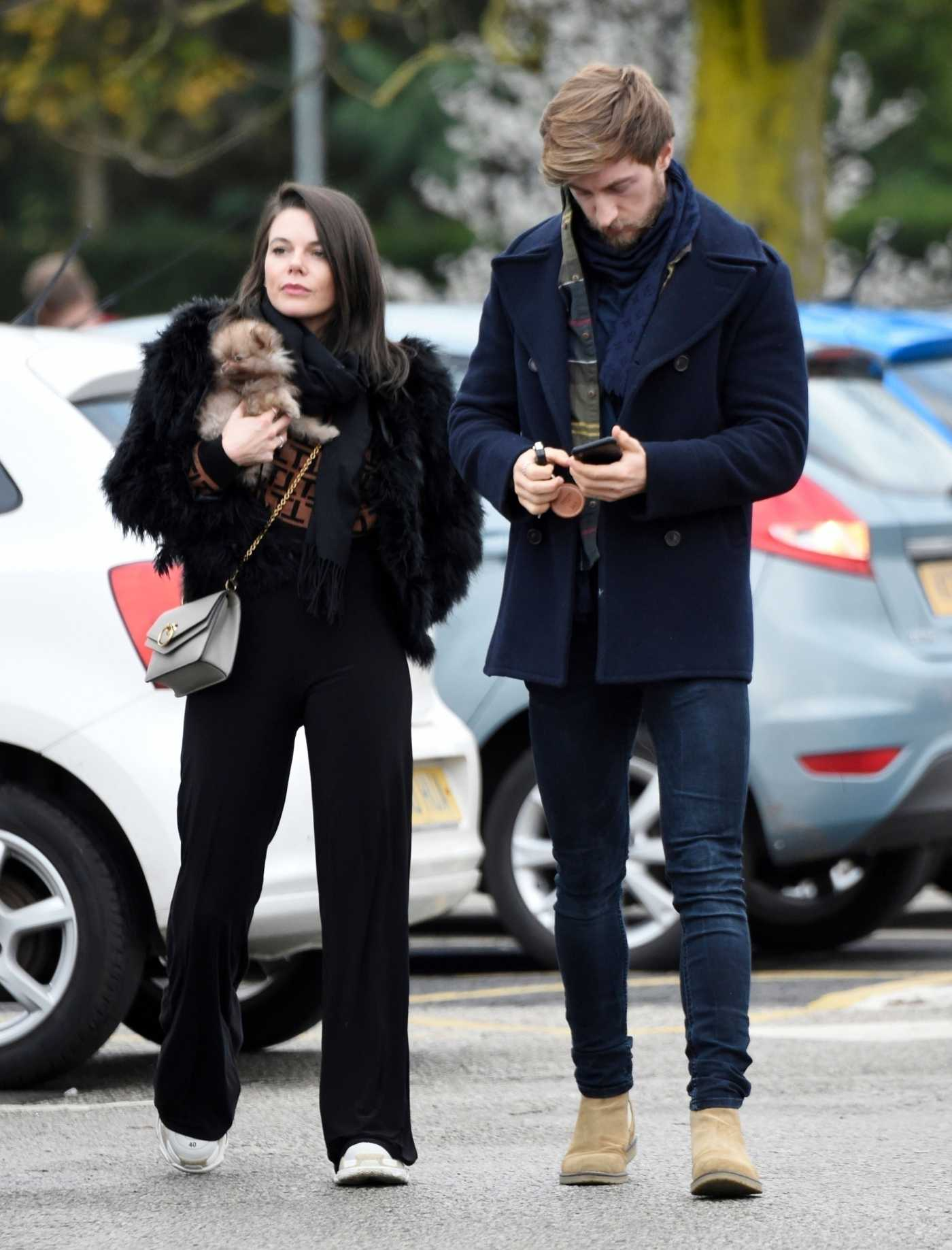 Faye Brookes in a Black Pants Was Seen with Her Puppy and Boyfriend while Out Christmas Shopping in Warrington 11/27/2020