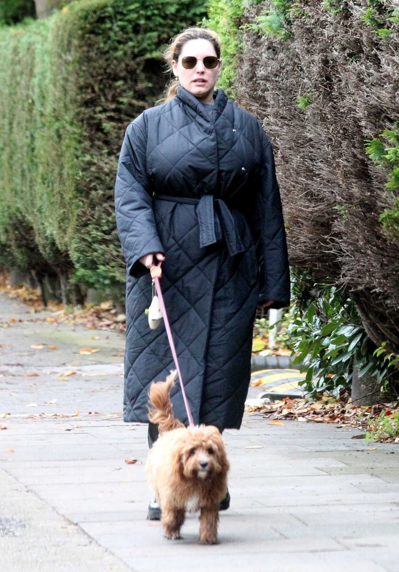 Kelly Brook in a Black Puffer Coat Walks Her Pet Dog Teddy in London 11/03/2020