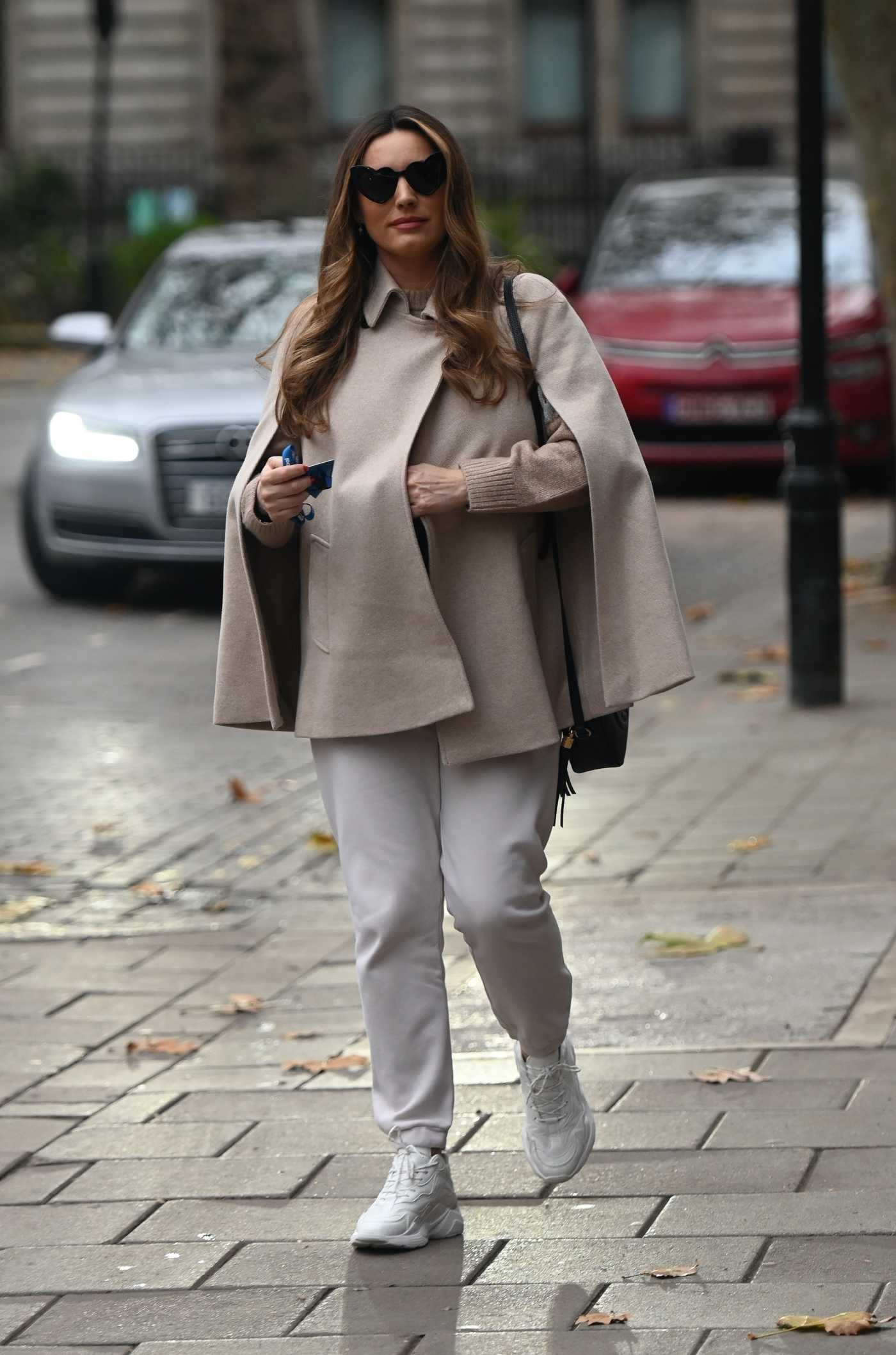 Kelly Brook in a White Sneakers Arrives at the Global Radio in London 11/18/2020