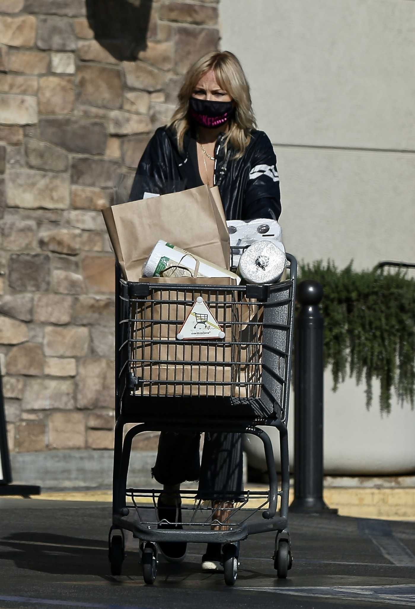 Malin Akerman in a Black Ripped Jeans Stocks up on Groceries at Gelson's Market in Los Feliz 11/12/2020