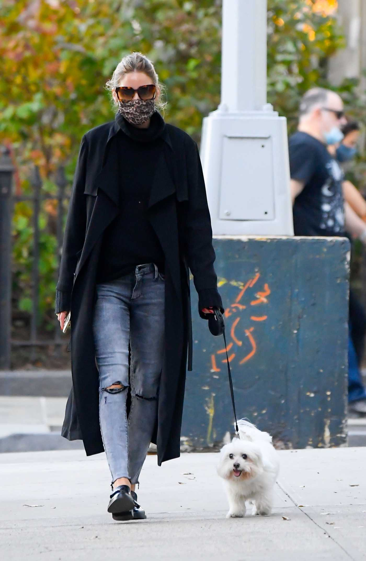 Olivia Palermo in a Black Trench Coat Walks Her Dog in New York 11/10/2020