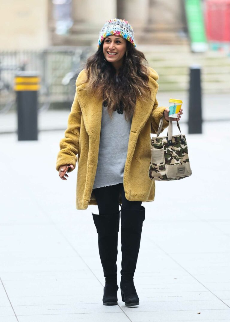 Preeya Kalidas in a Yellow Fur Coat