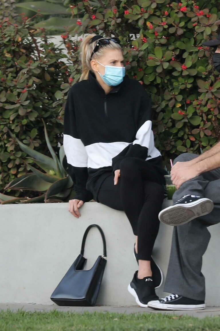 Charlotte McKinney in a Protective Mask