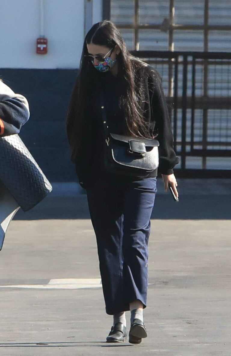 Demi Moore in a Protective Mask