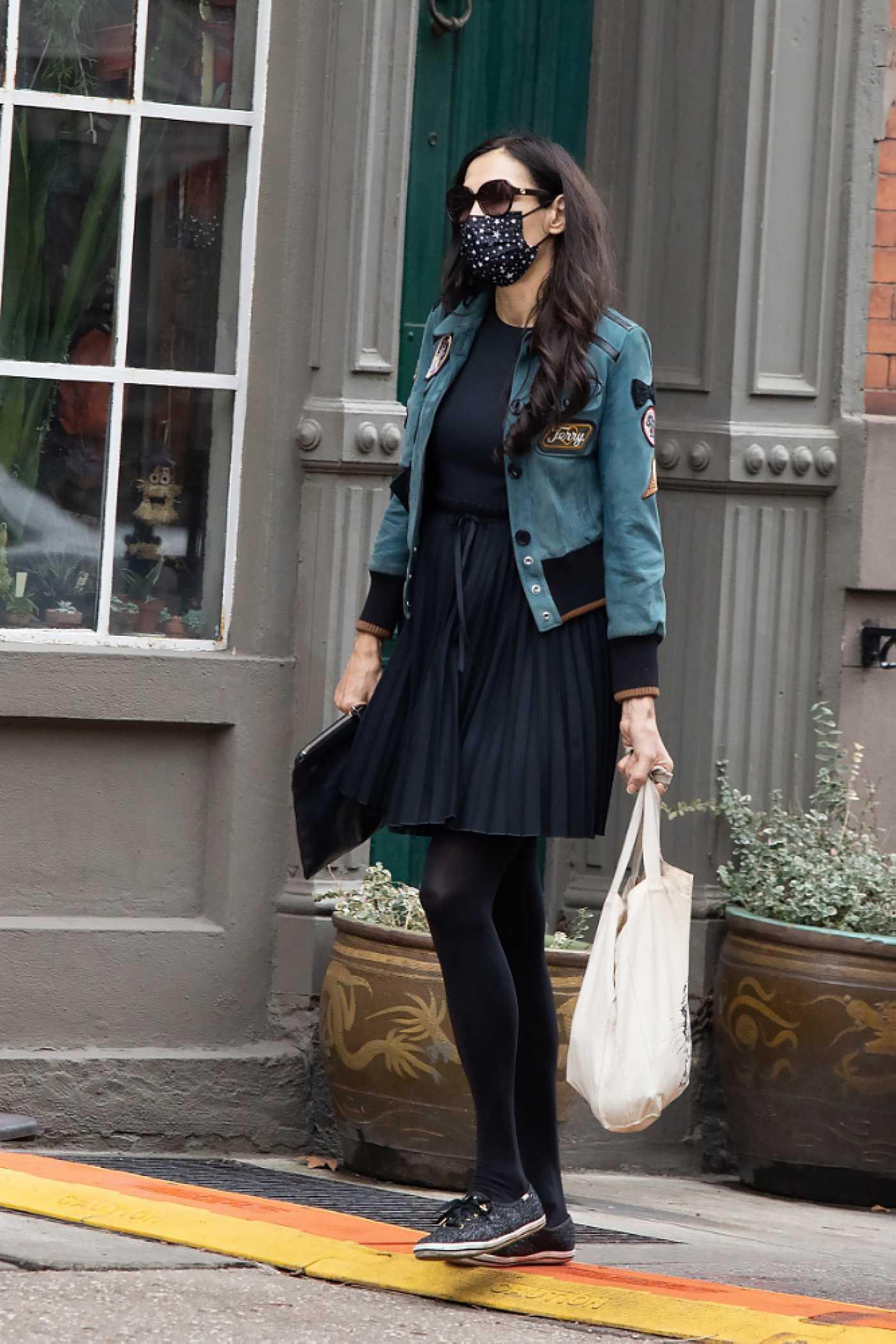 Famke Janssen in a Black Skirt Was Seen Out in New York 12/24/2020