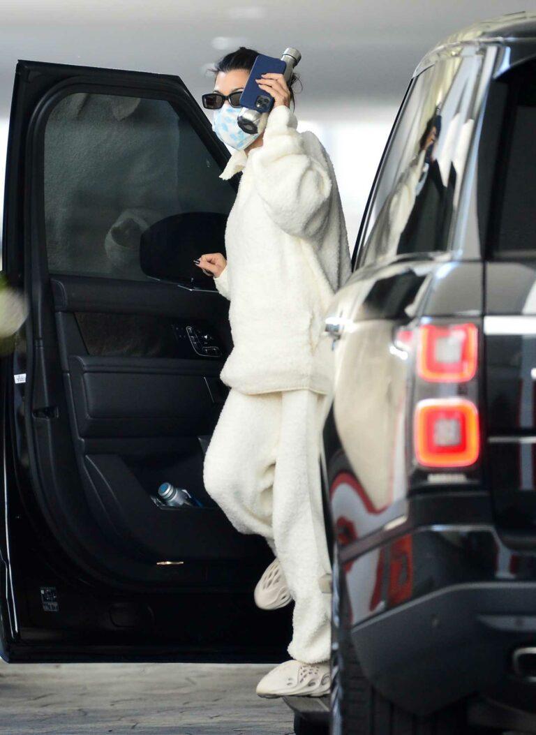 Kourtney Kardashian in a White Sweatshirt