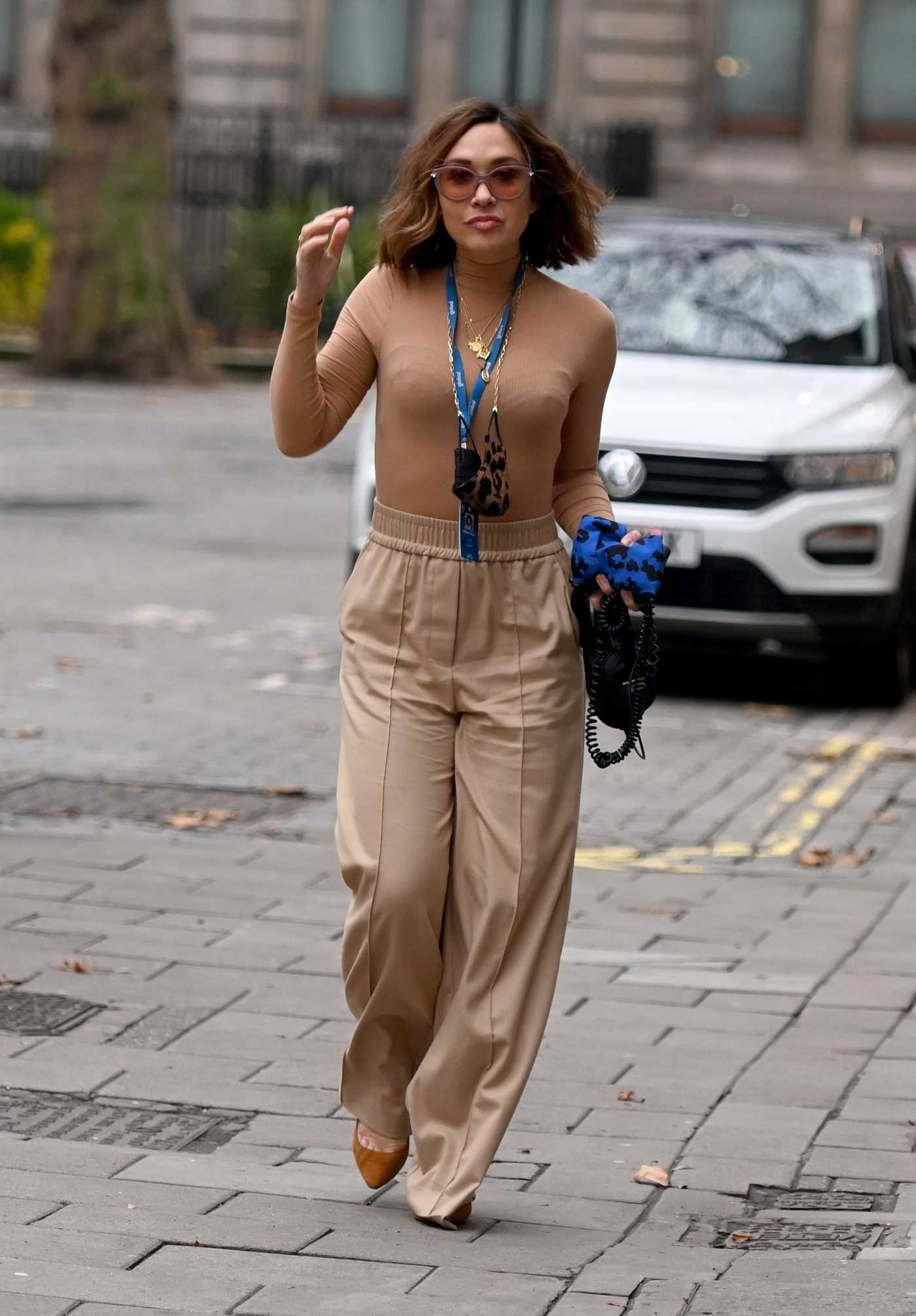 Myleene Klass in a Beige Pants Arrives at the Global Radio in London 12/22/2020