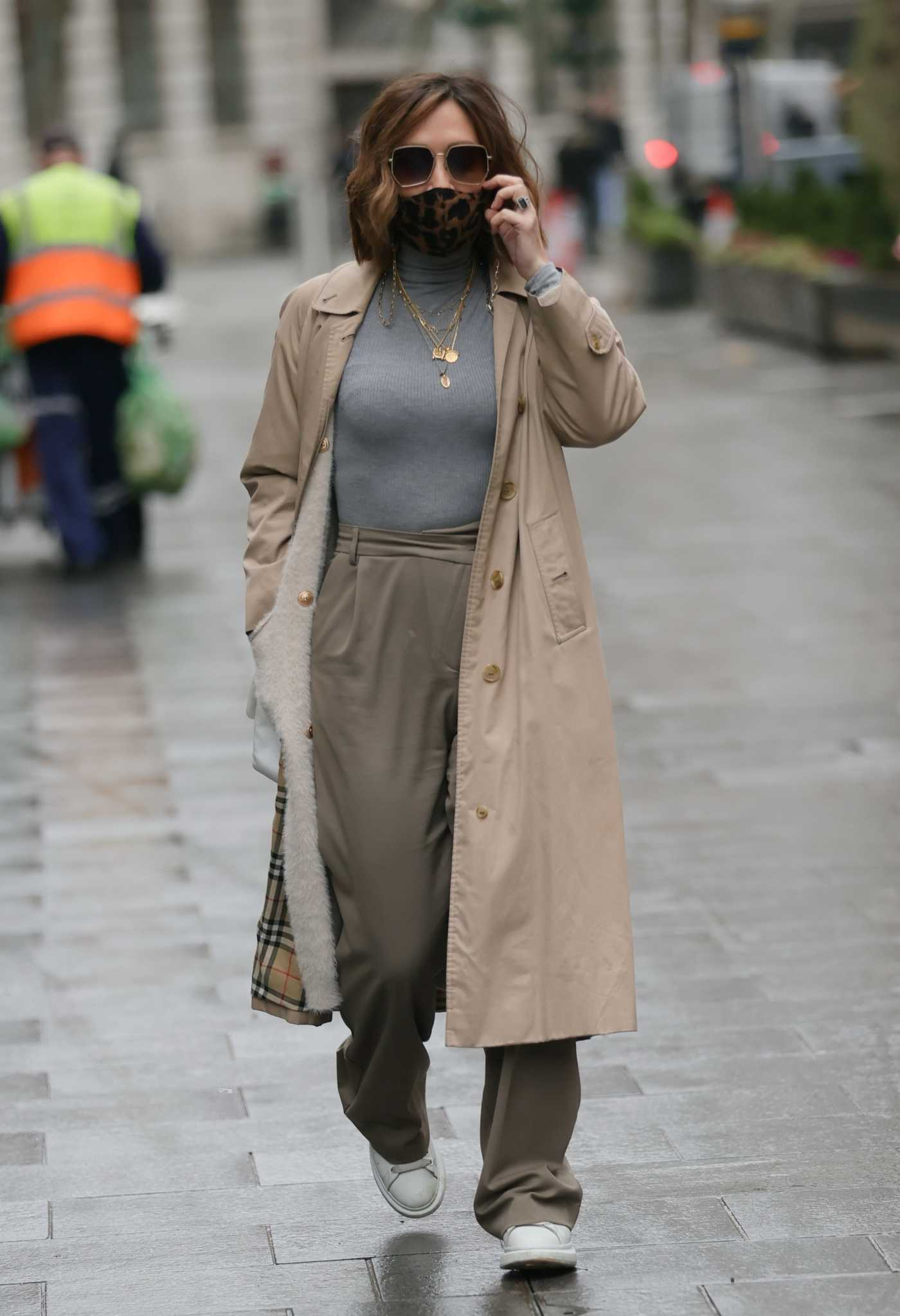 Myleene Klass in a Beige Trench Coat Arrives at the Smooth Radio in London 12/14/2020