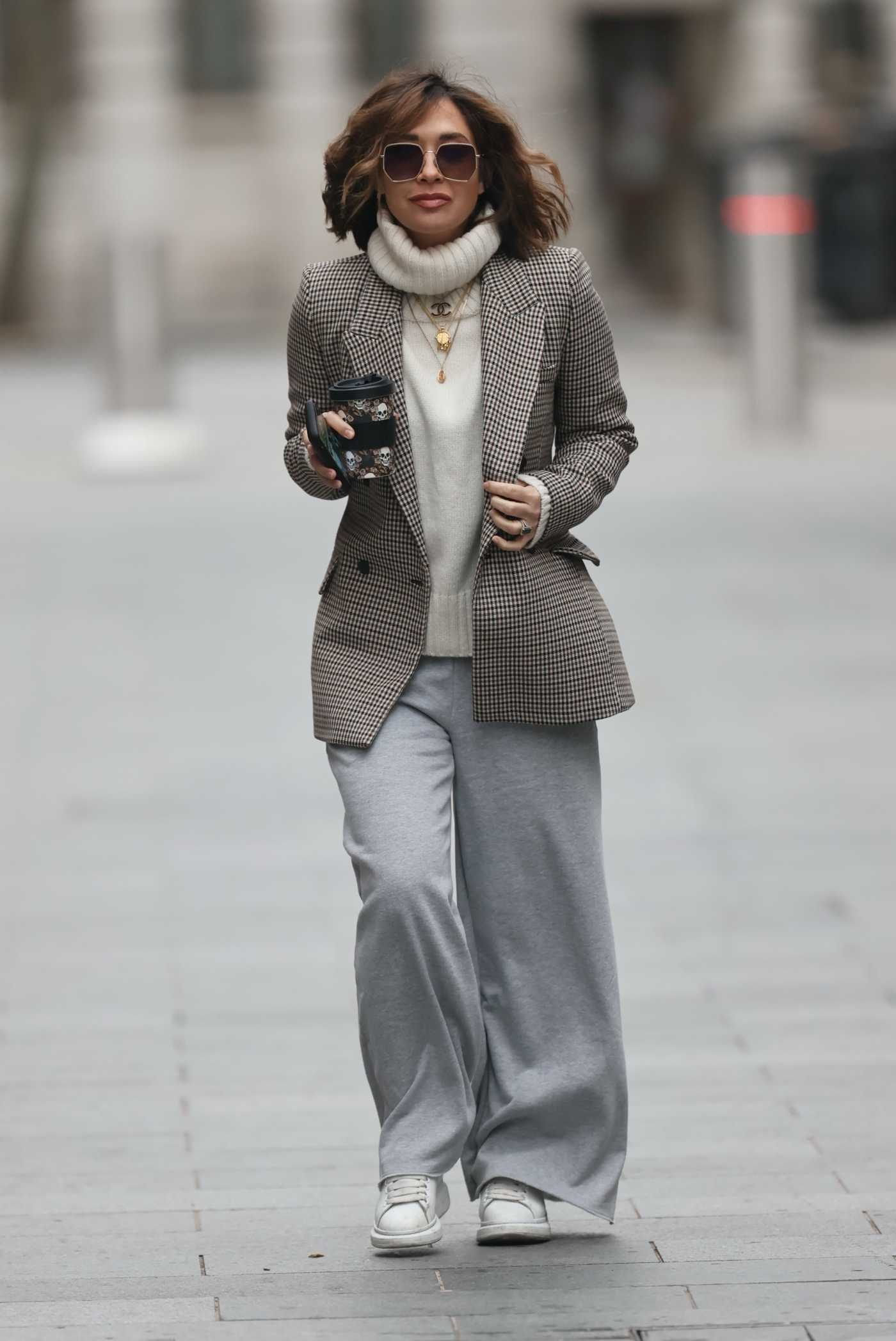 Myleene Klass in a Gray Flared Sweatpants Arrives at the Smooth Radio in London 12/26/2020