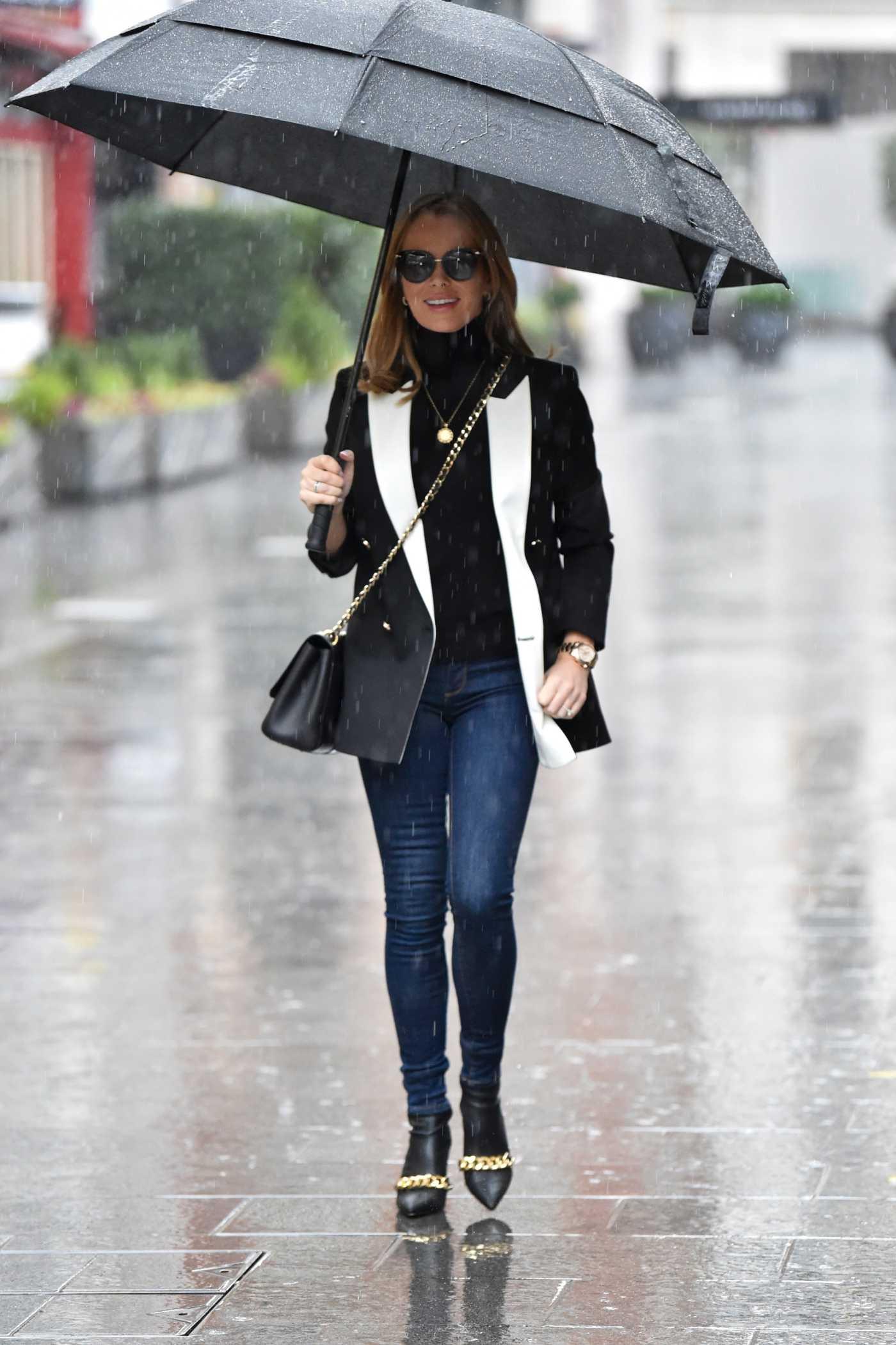 Amanda Holden in a Black Blazer Leaves the Heart Radio in the Rain in London 01/29/2021