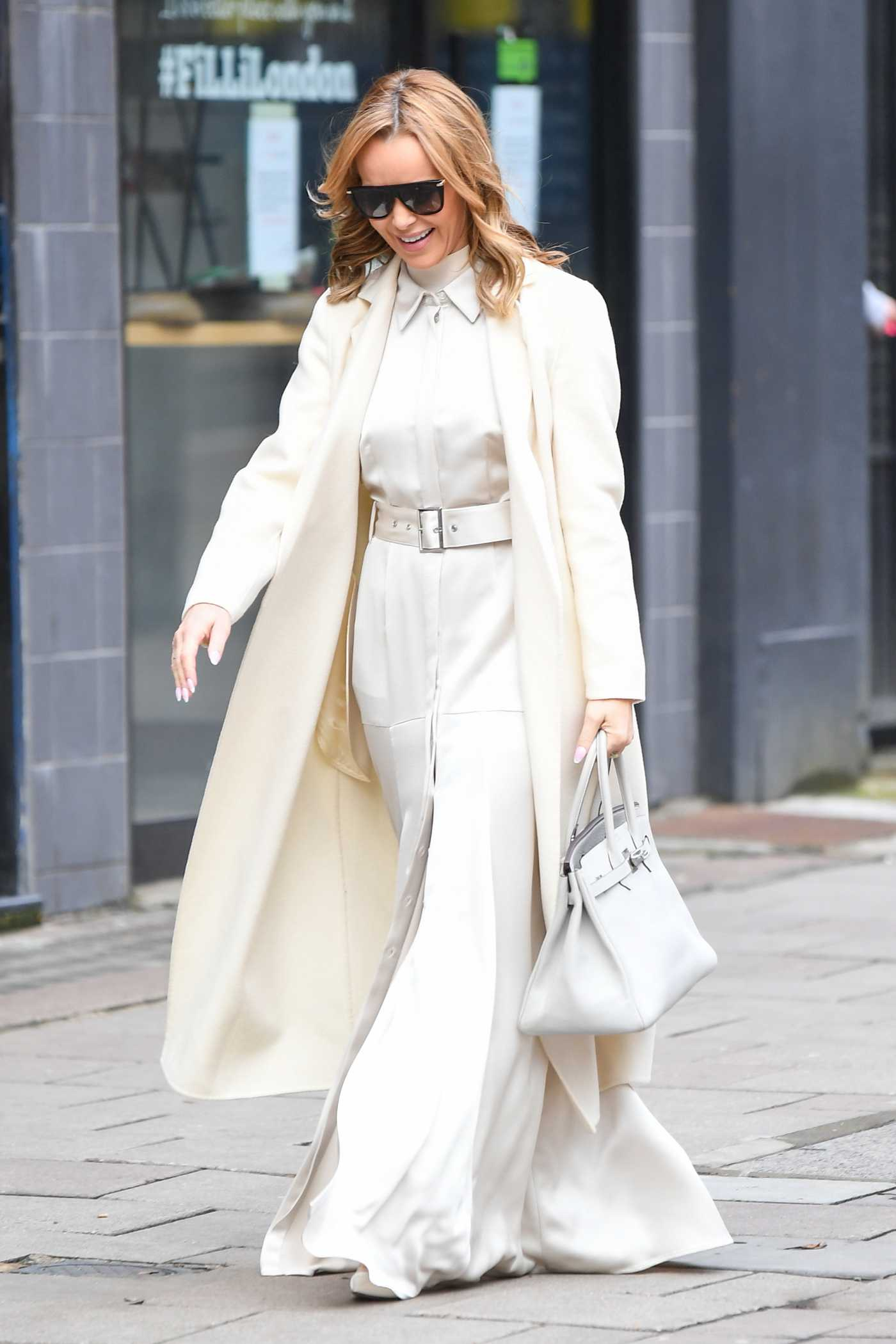 Amanda Holden in a White Coat Leaves the Global Studios in London 01/15/2021