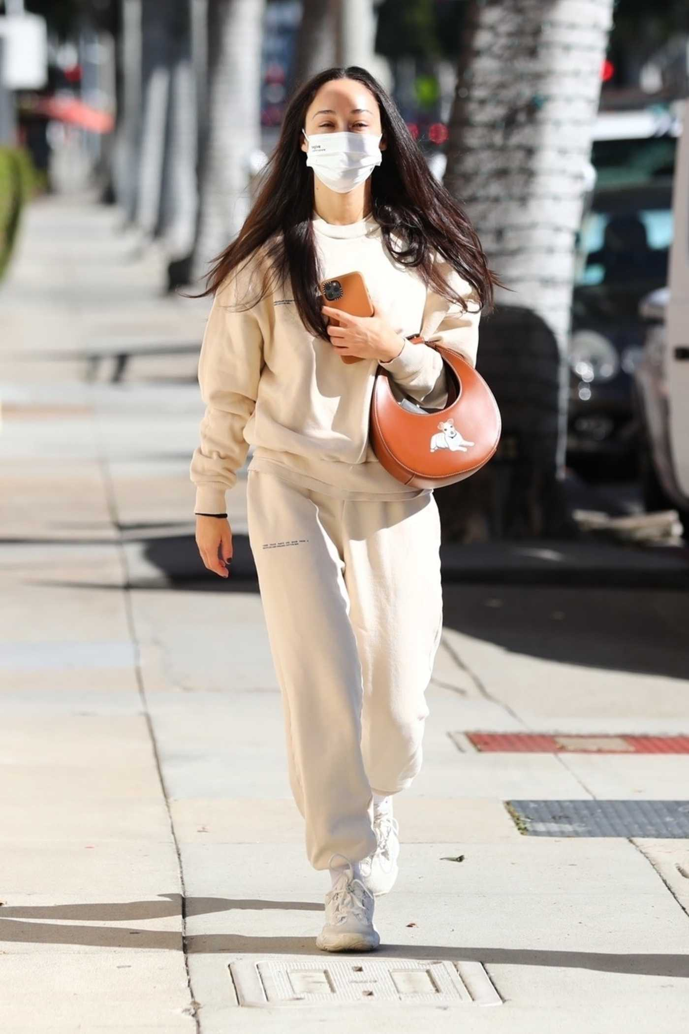Cara Santana in a Beige Sweatsuit Arrives at a Skin Center in Beverly Hills 01/14/2021