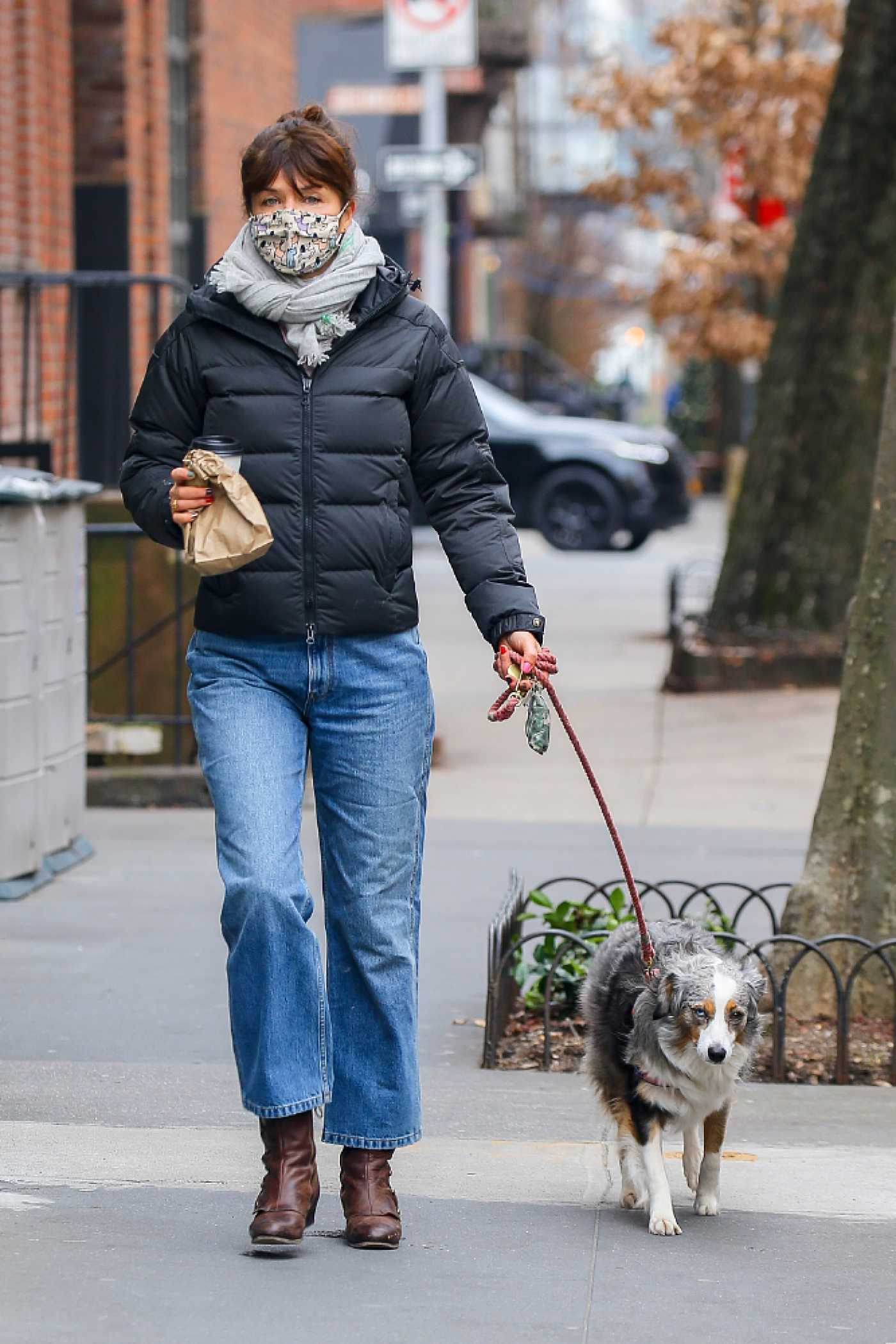 Helena Christensen in a Black Jacket Walks Her Dog in New York 01/11/2021