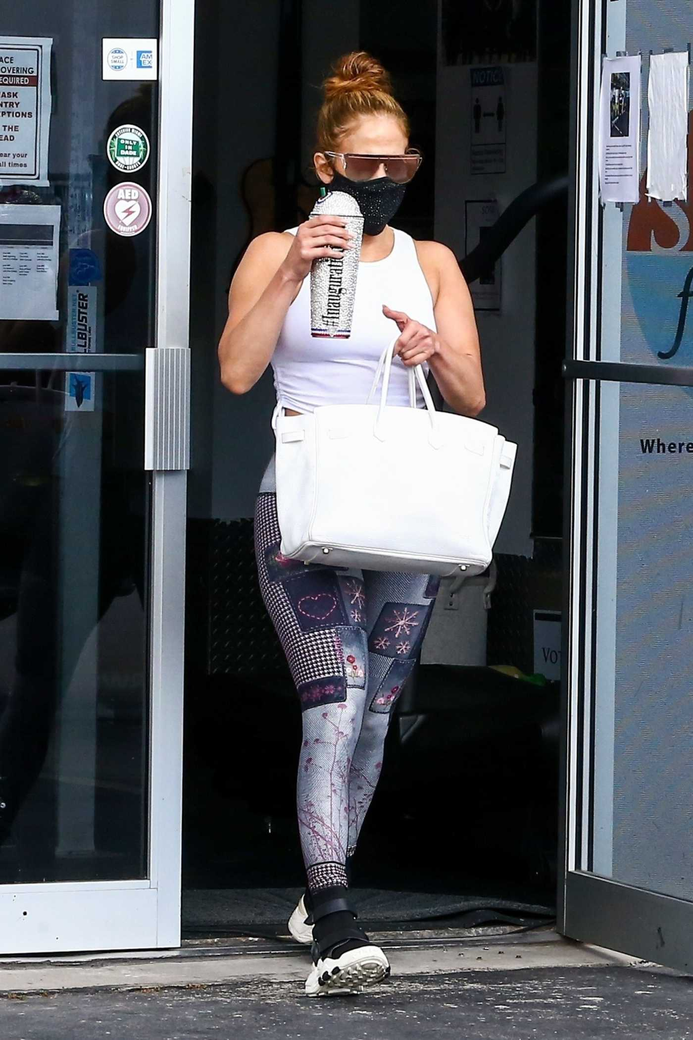 Jennifer Lopez in a White Top Leaves the Gym in Miami 01/24/2021