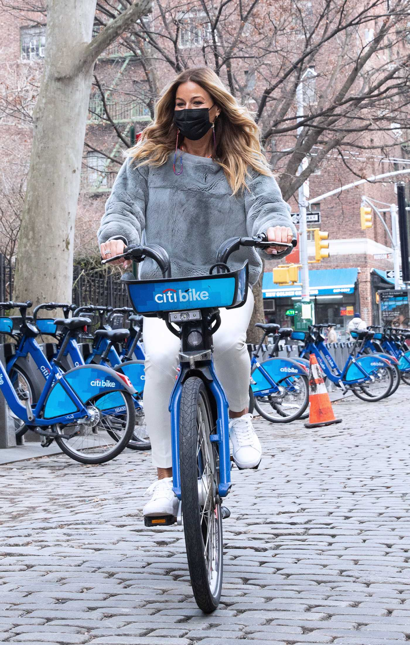 Kelly Bensimon in a White Sneakers Does a Bike Ride in New York 01/13/2021