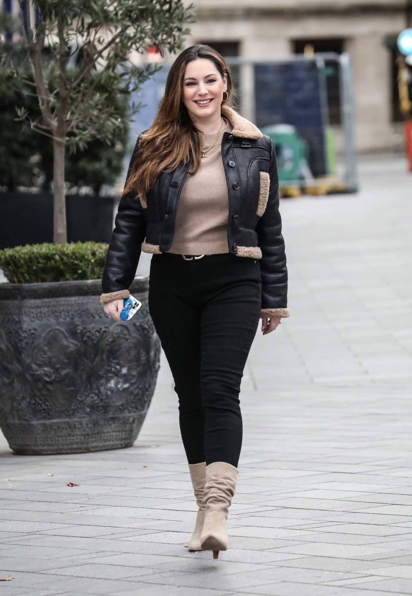 Kelly Brook in a Black Jacket Arrives at the Global Radio Studios in London 01/11/2021