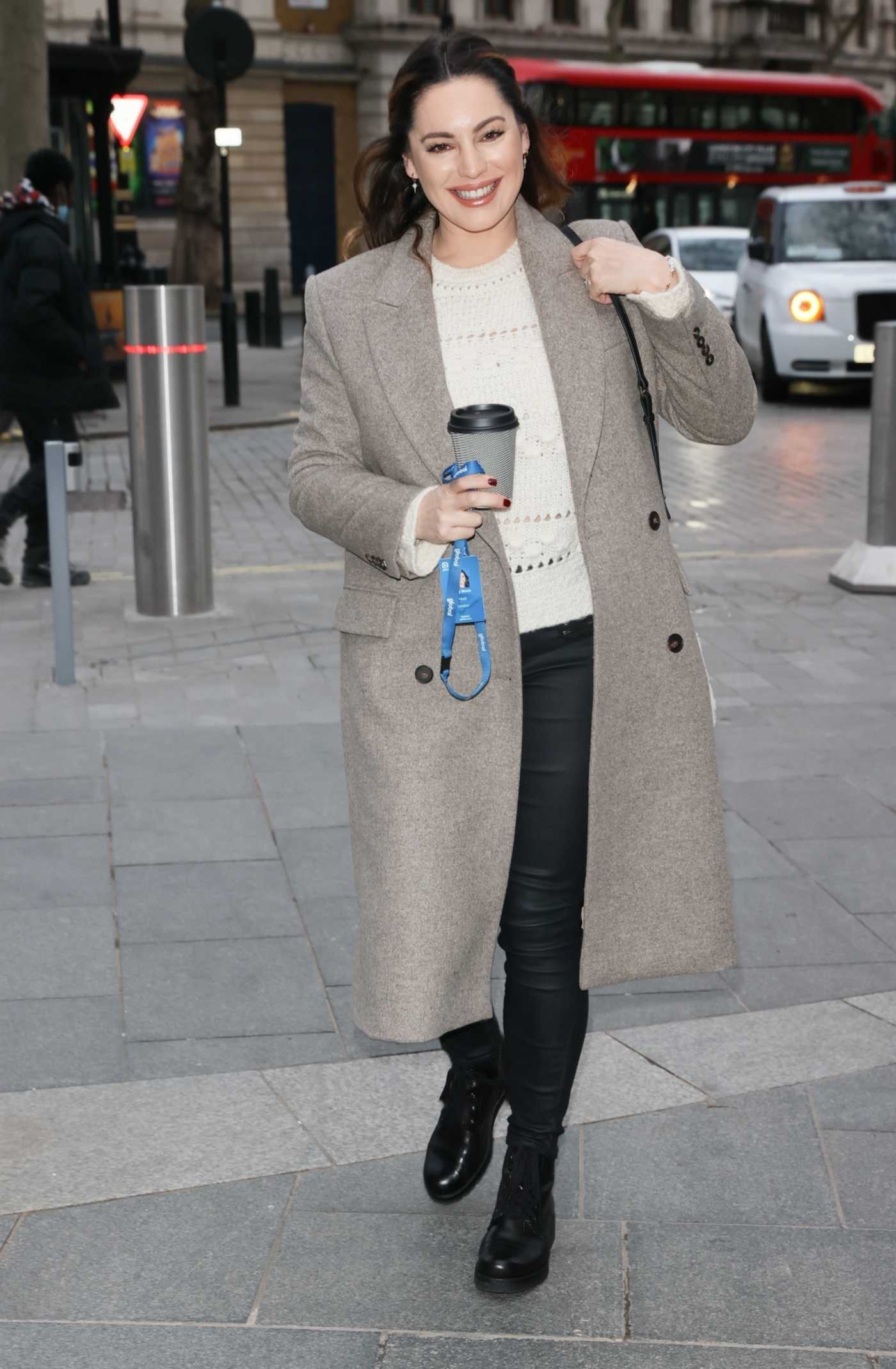 Kelly Brook in a Grey Coat Arrives at the Global Radio Studios in London 01/22/2021