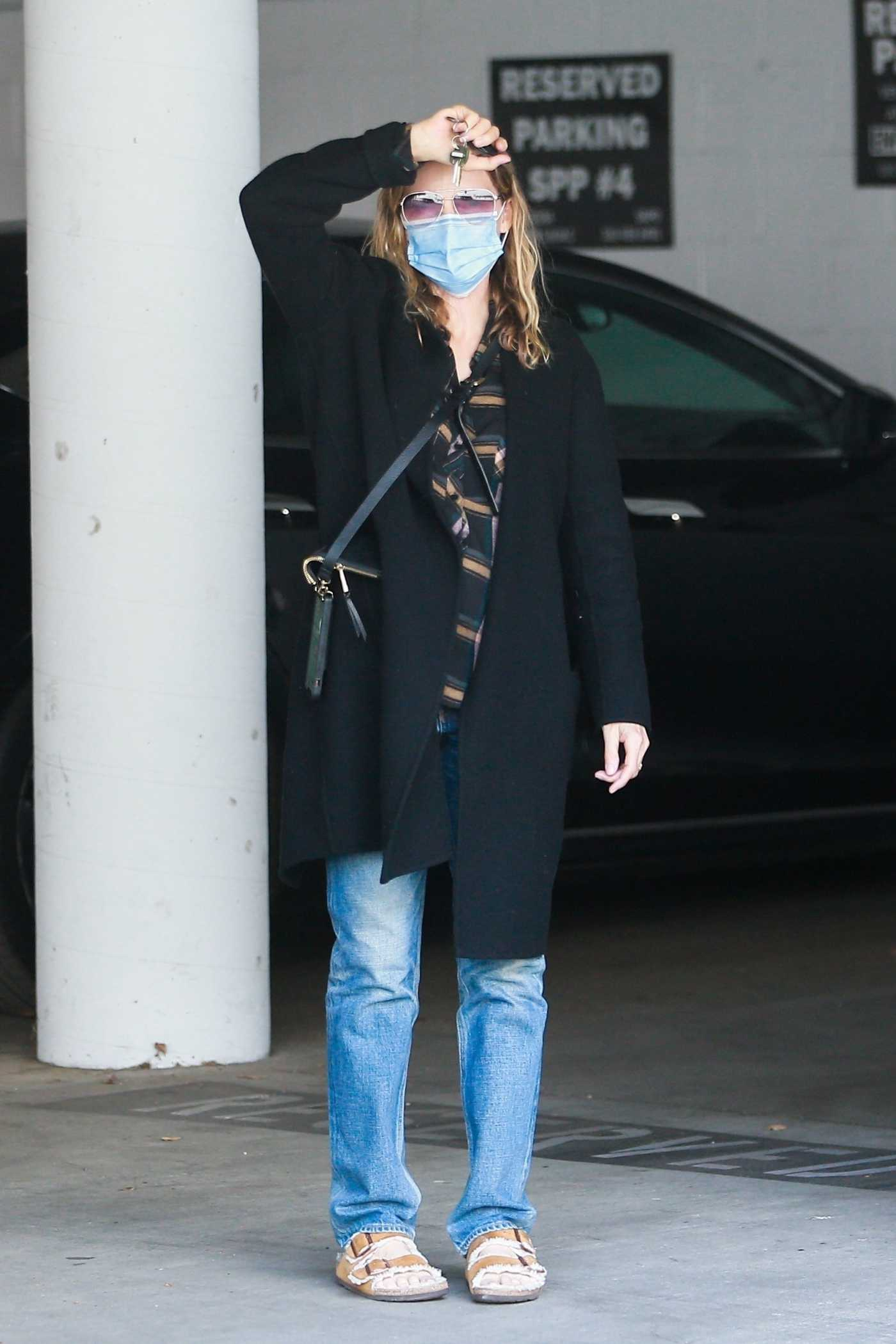 Michelle Pfeiffer in a Black Coat Heads to Her Office in Santa Monica 01/11/2021
