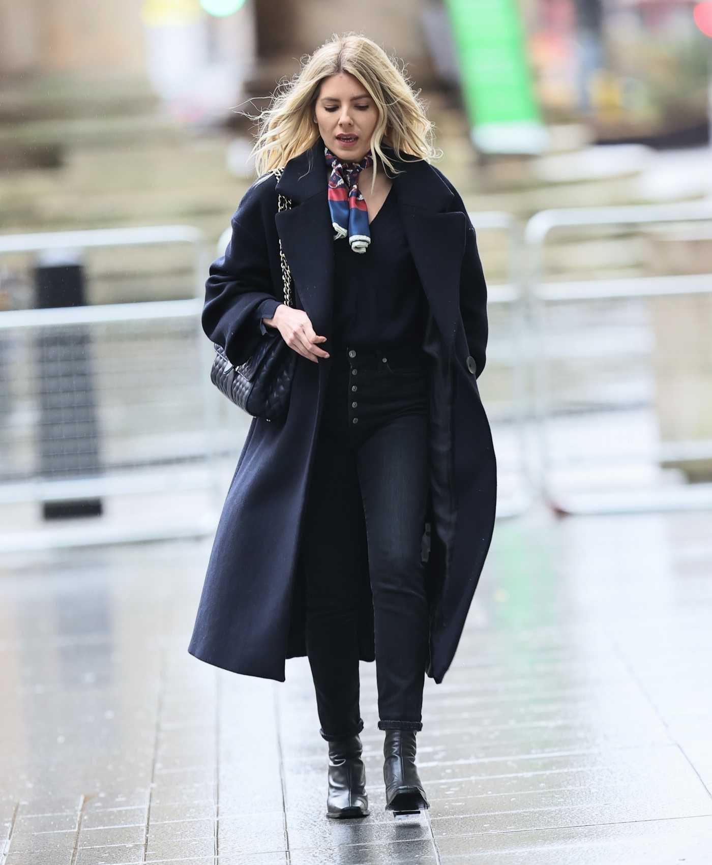 Mollie King in a Black Coat Arrives at the BBC Radio 1 in London 01/16/2021