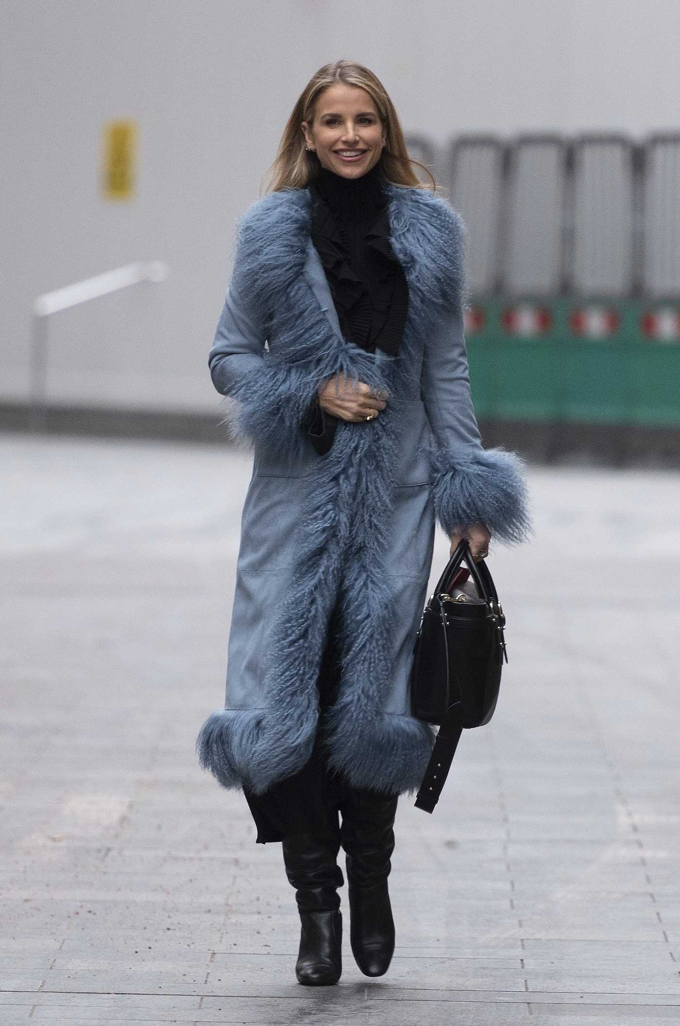 Vogue Williams in a Blue Coat Leaves the Global Radio in London 01/24/2021
