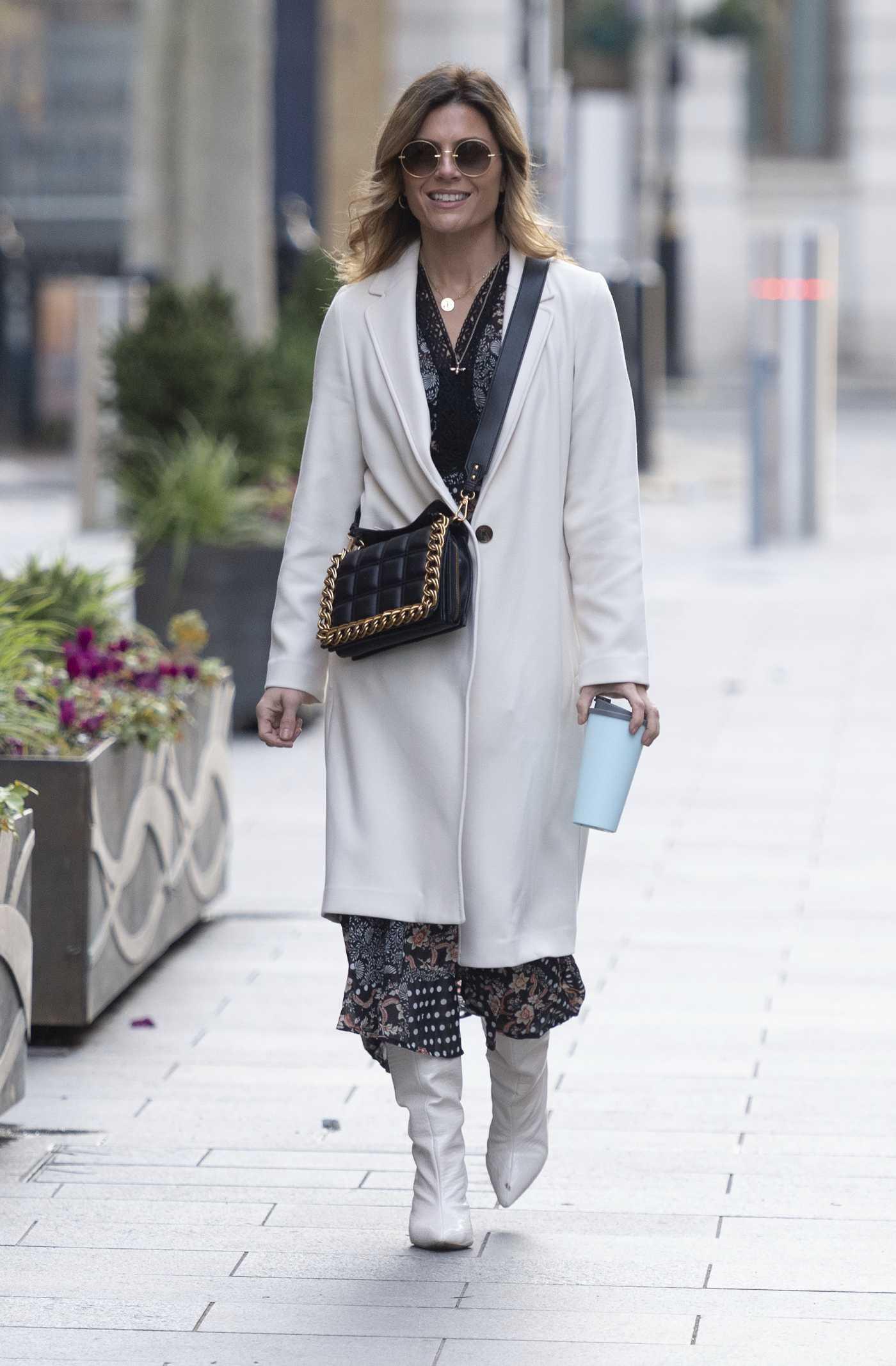 Zoe Hardman in a White Coat Arrives at the Global Radio Studios in London 01/31/2021