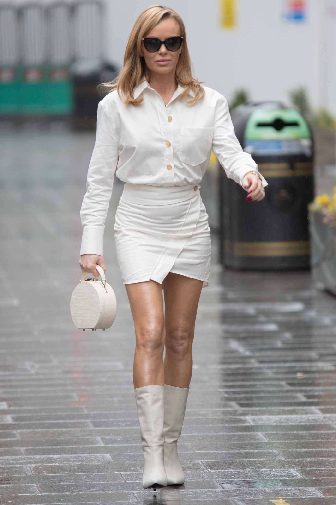 Amanda Holden in a White Mini Skirt Arrives at the Heart Radio in London 02/25/2021