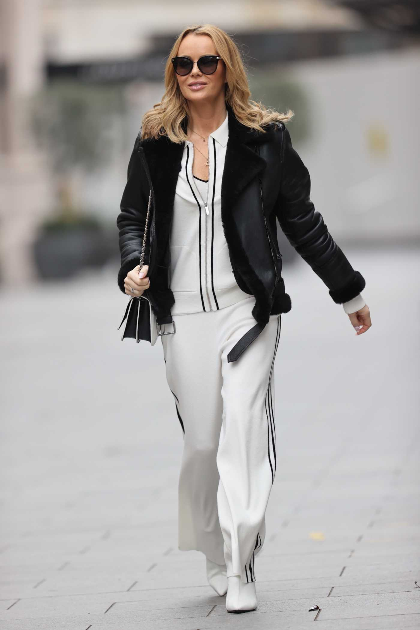 Amanda Holden in a White Sweatsuit Leaves the Global Studios in London 02/01/2021