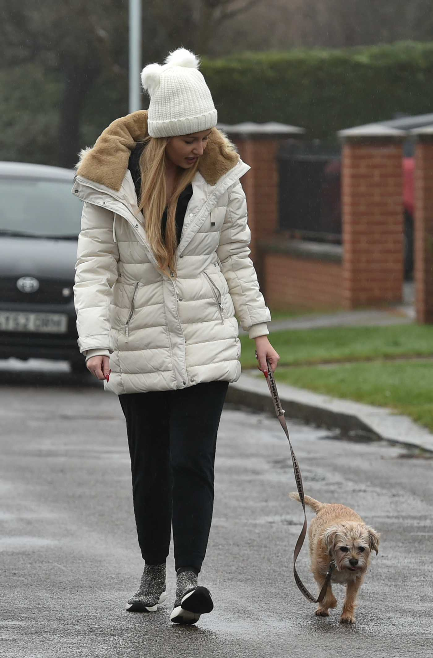 Amy Hart in a White Beanie Hat Walks Her Dog in Worthing, Sussex 02/21/2021