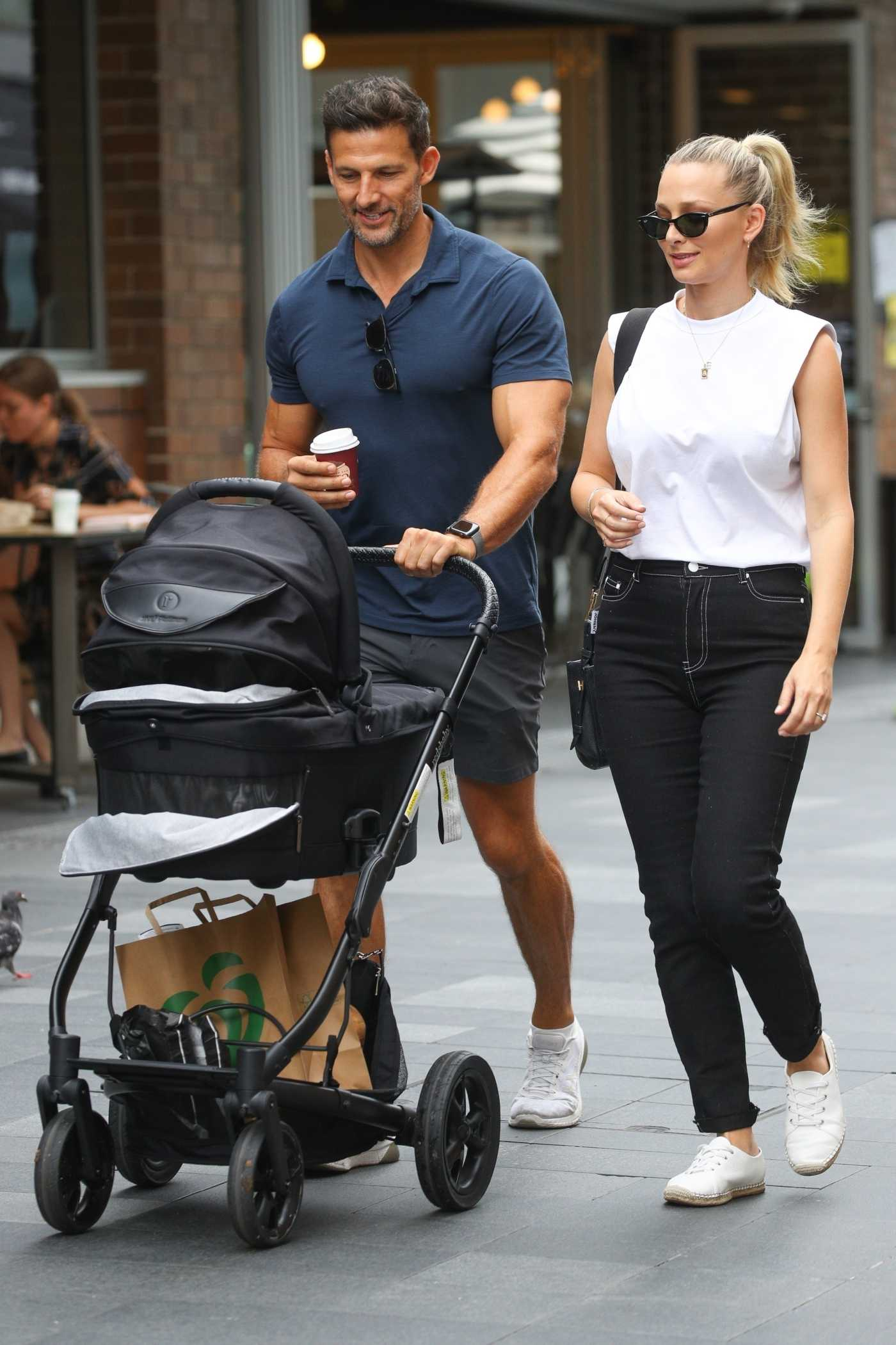 Anna Heinrich in a White Tee Takes Her Newborn Out for a Stroll with Tim Robards in Sydney 02/25/2021
