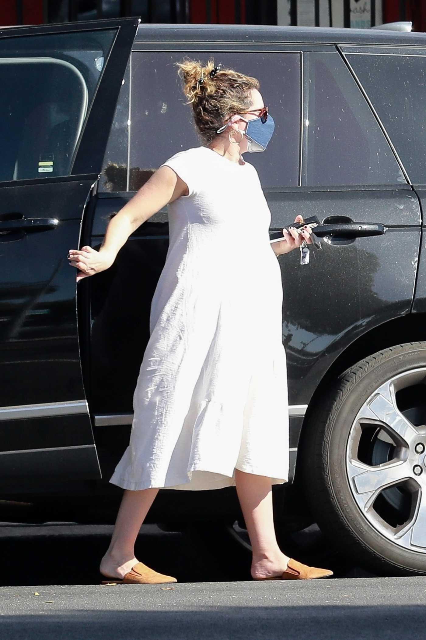 Ashley Tisdale in a White Dress Was Seen Out in Los Feliz 02/27/2021