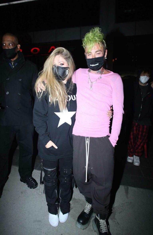 Avril Lavigne in a Black Hoodie