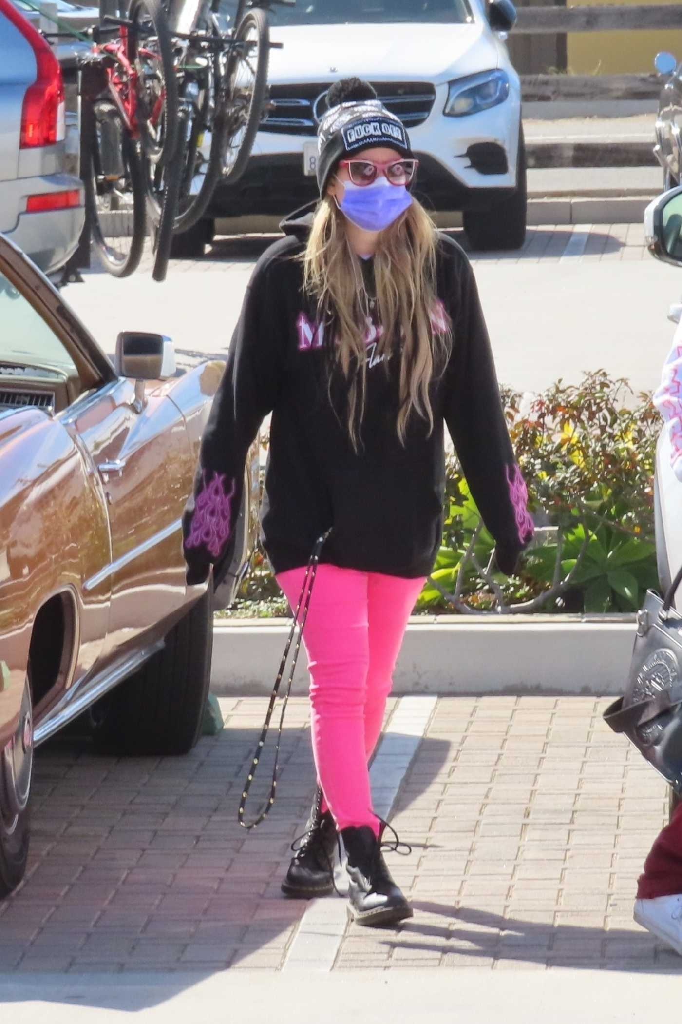 Avril Lavigne in a Pink Sweatpants Was Seen Out with Mod Sun on Valentine's Day in Malibu 02/14/2021