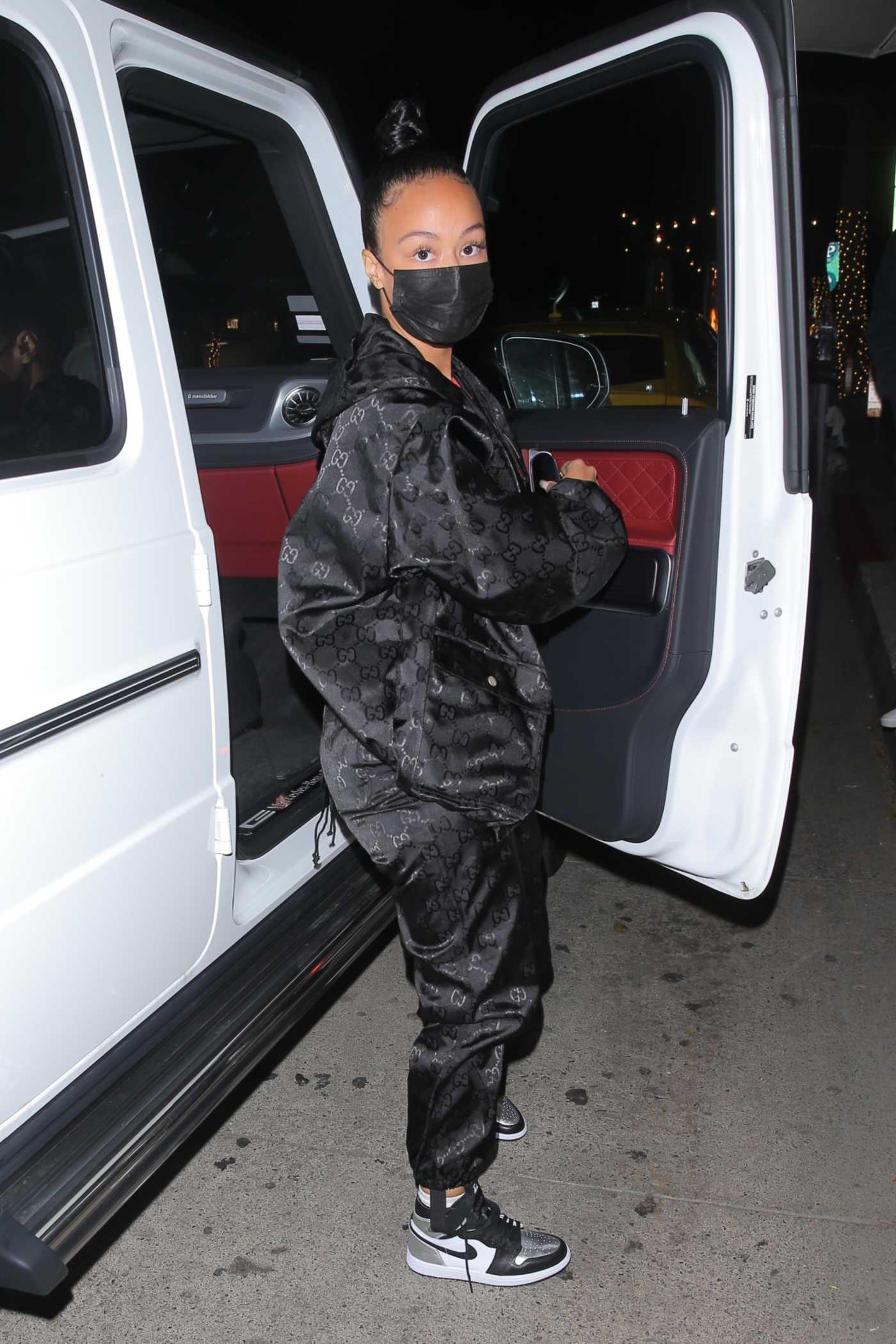Draya Michele in a Black Sweatsuit Enjoys a Date Night at Mr. Chow in Beverly Hills 02/24/2021
