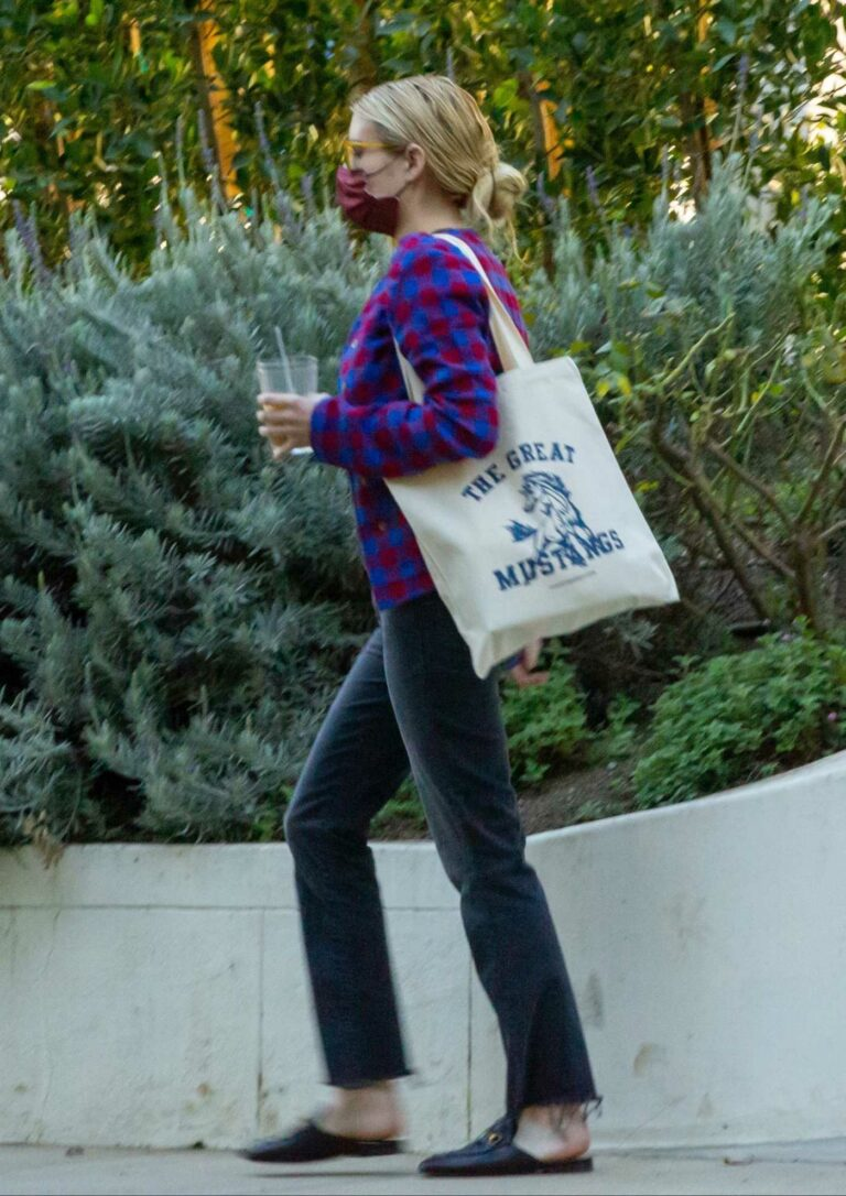 Emma Roberts in a Plaid Cardigan