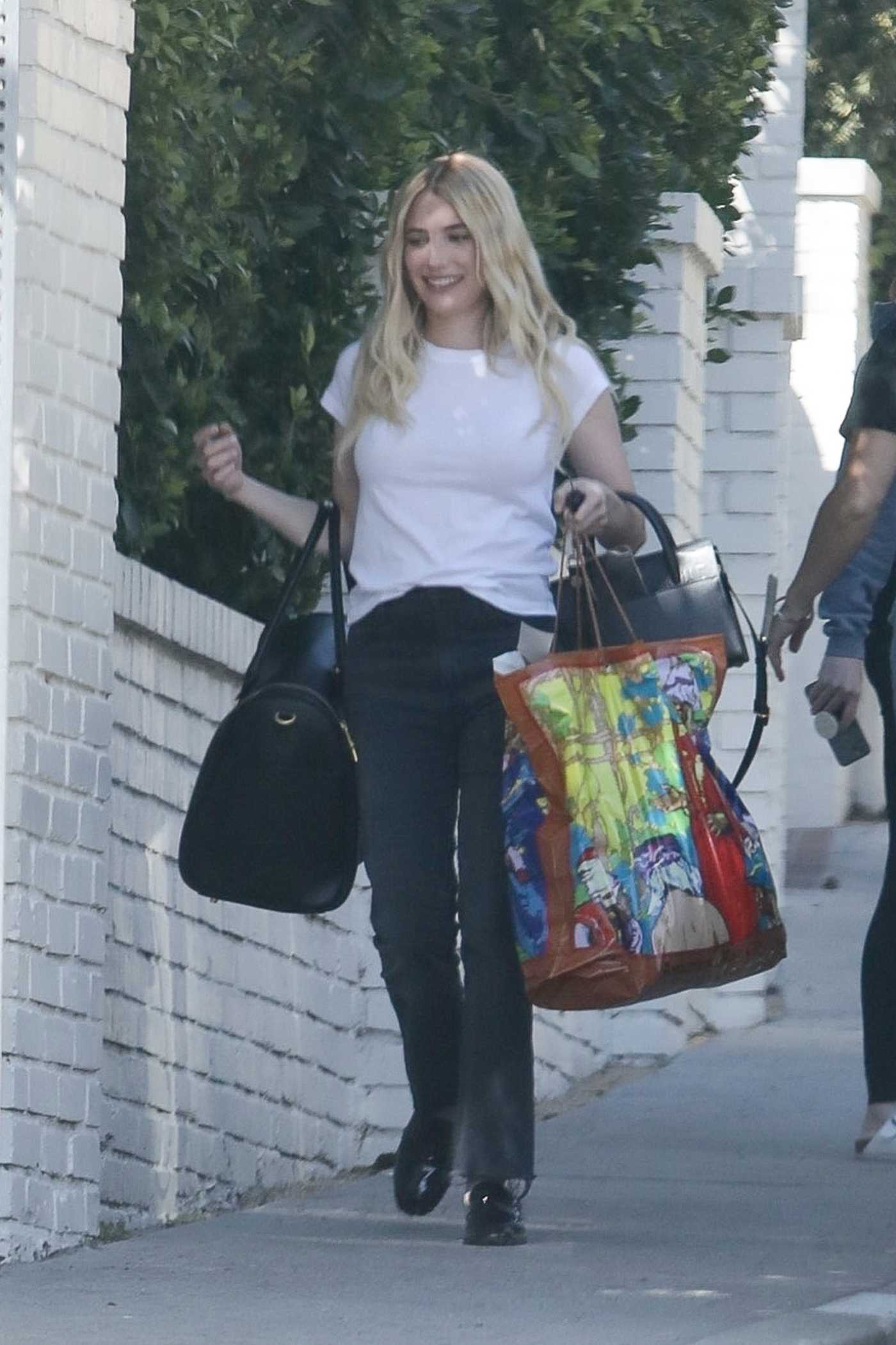 Emma Roberts in a White Tee Heads to a Photoshoot in Los Angeles 02/26/2021