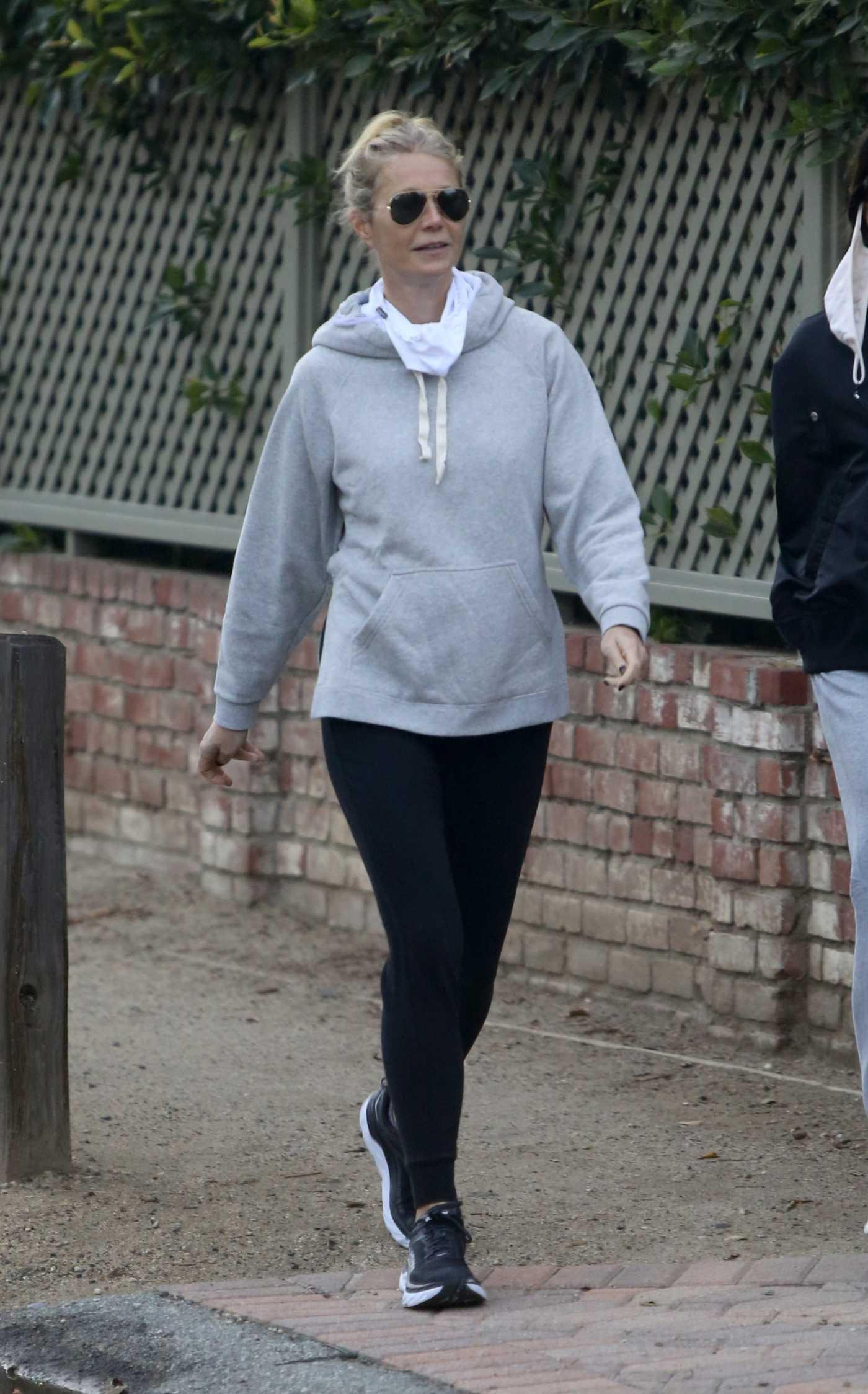 Gwyneth Paltrow in a Grey Hoodie Takes a Walk with a Friend in Brentwood 02/02/2021