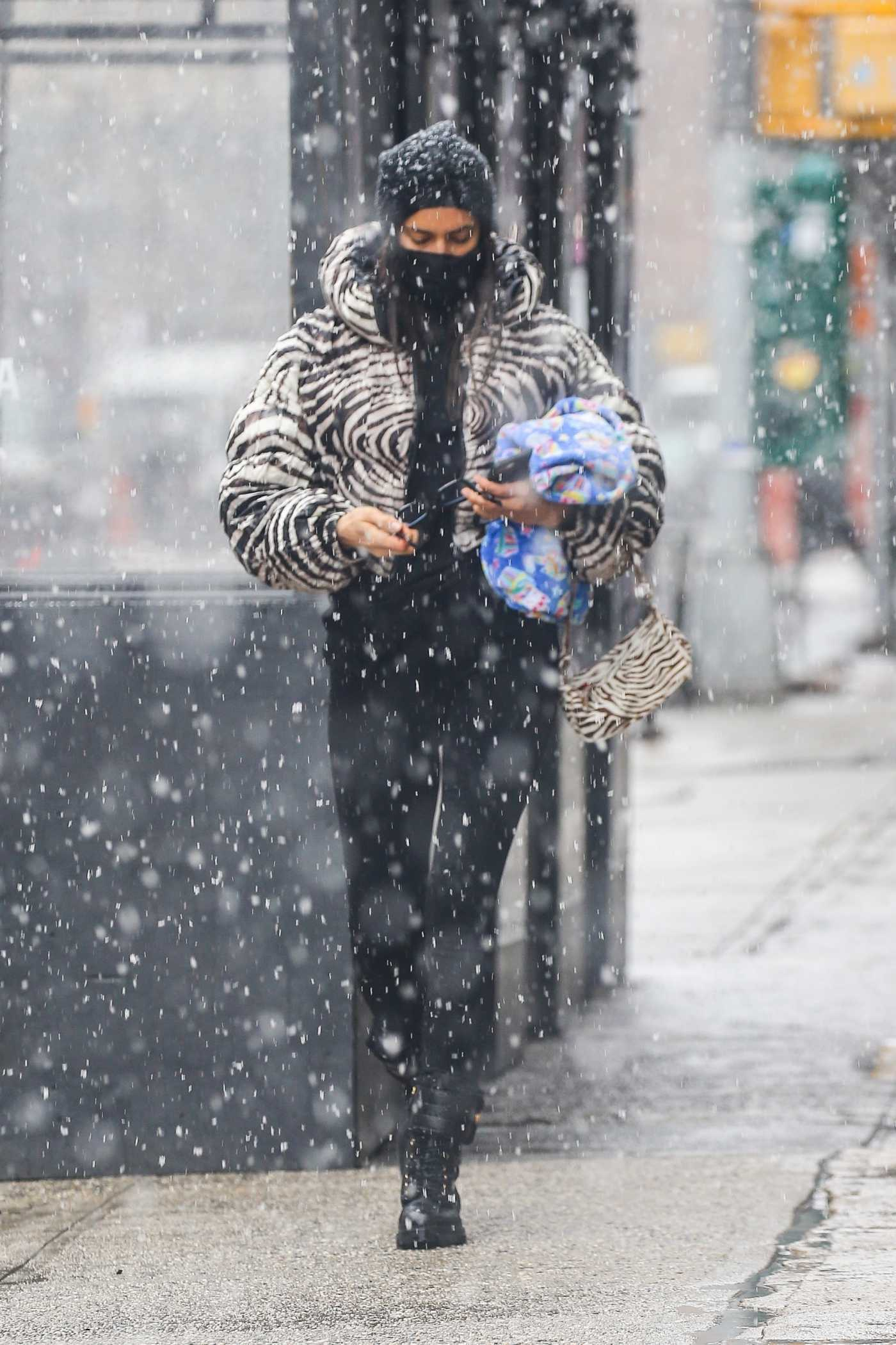 Irina Shayk in a Zebra Print Puffer Jacket Was Spotted During a Snowy Day in New York 02/22/2021