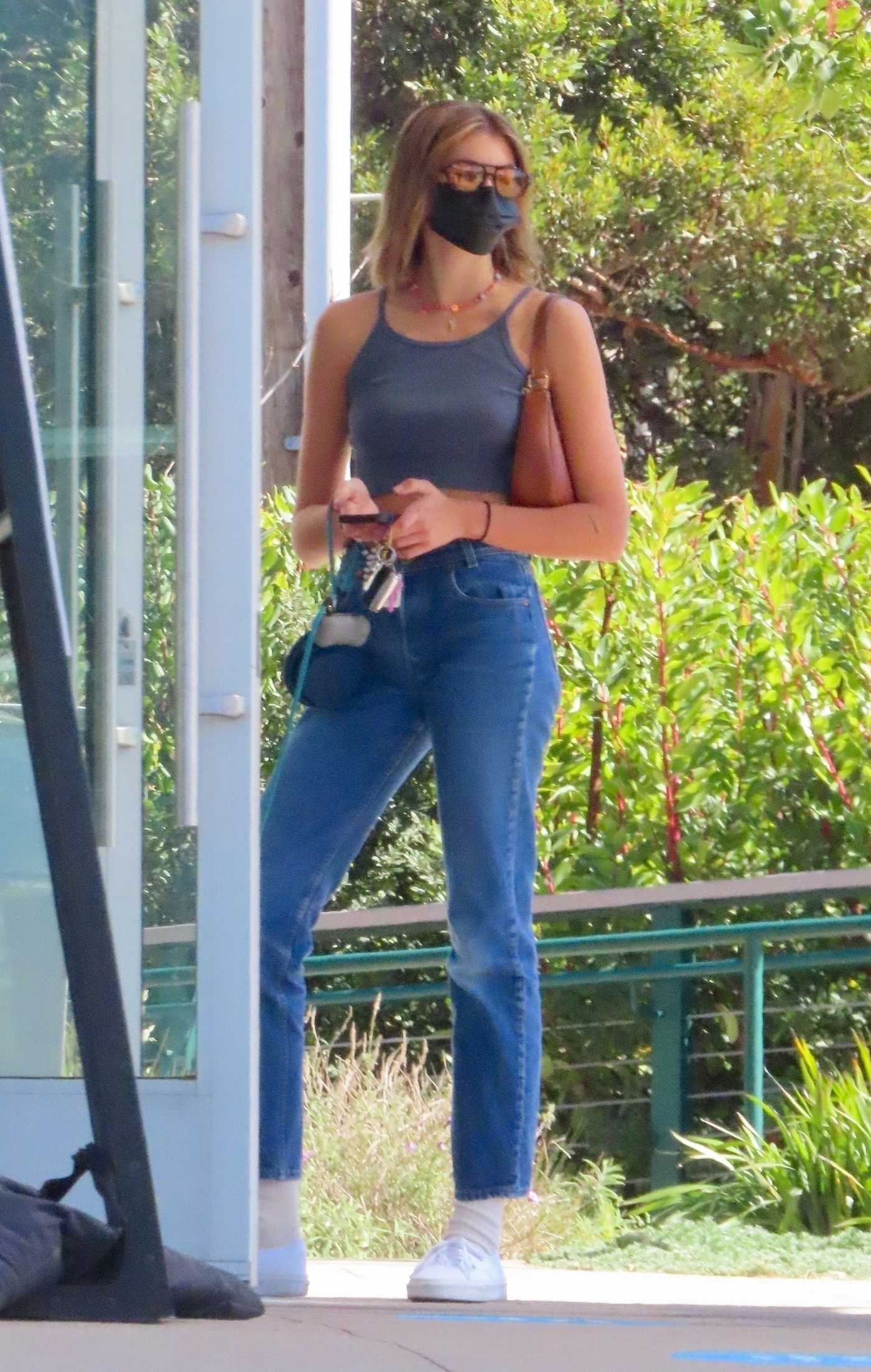 Kaia Gerber in a Grey Top Goes on a Coffee Run with Her Dog in Malibu 02/23/2021