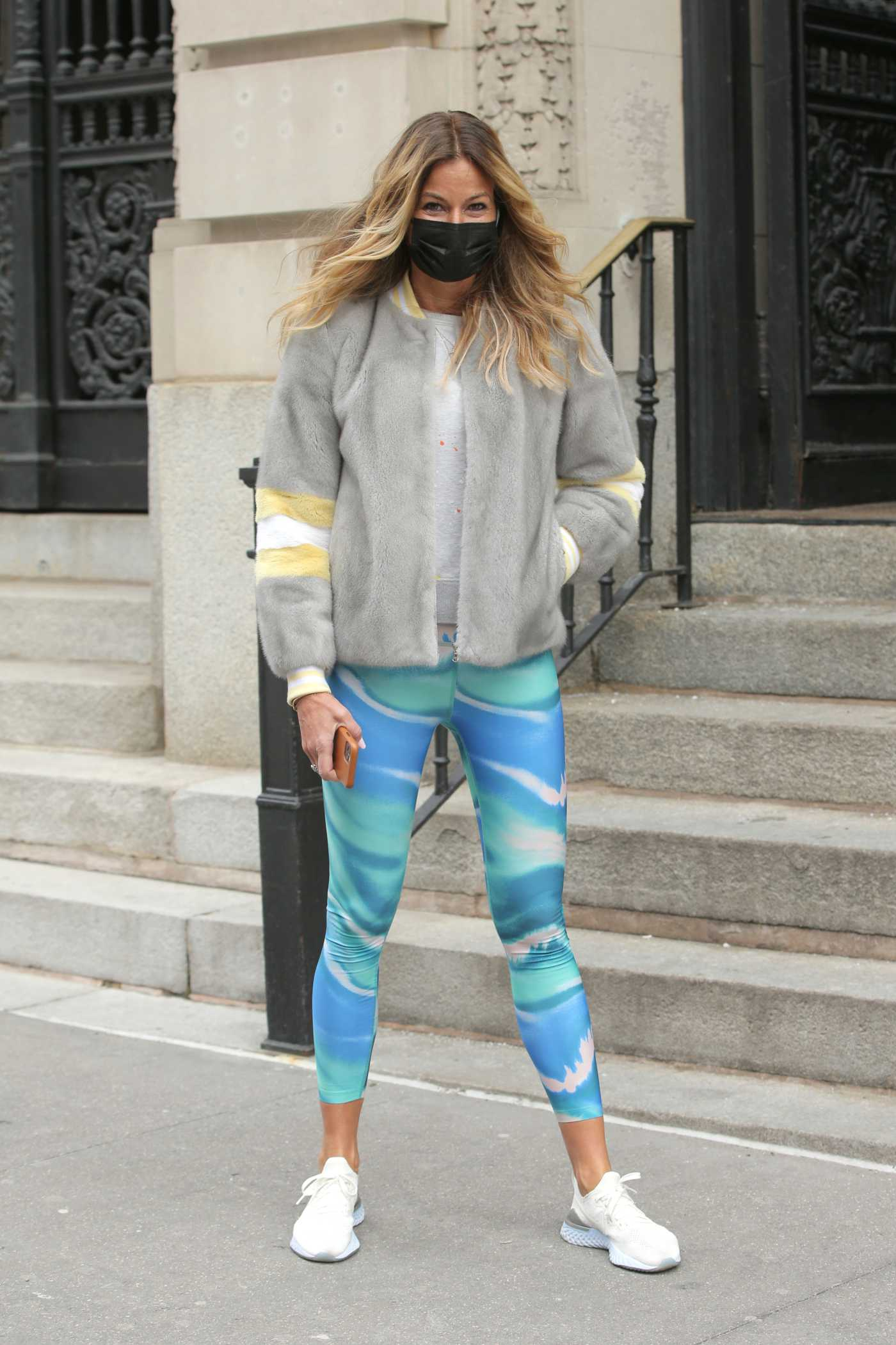 Kelly Bensimon in a Black Protective Mask Walks Her Dog in New York 02/12/2021