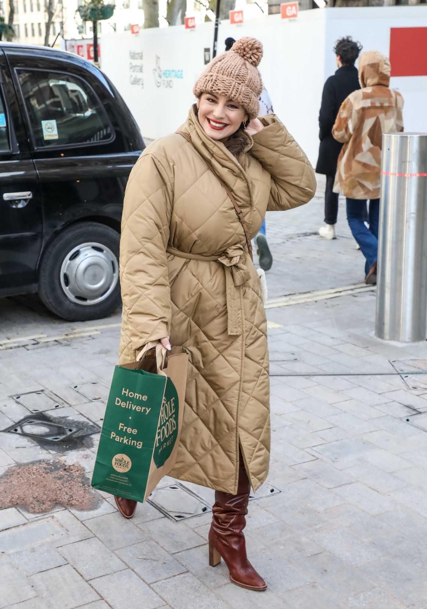 Kelly Brook in a Beige Puffer Coat Arrives at the Global Radio Studios in London 02/10/2021