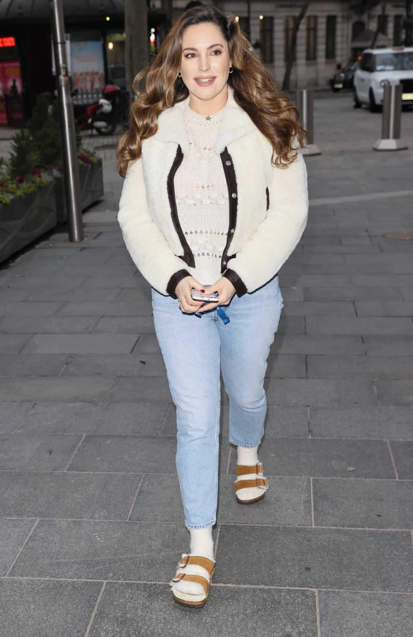 Kelly Brook in a Blue Jeans Arrives at the Heart Radio Show in London 02/01/2021