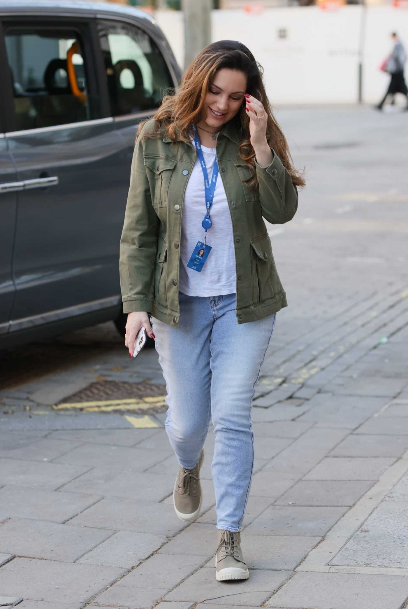Kelly Brook in a Khaki Jacket Arrives at the Heart Radio Studios in London 02/26/2021