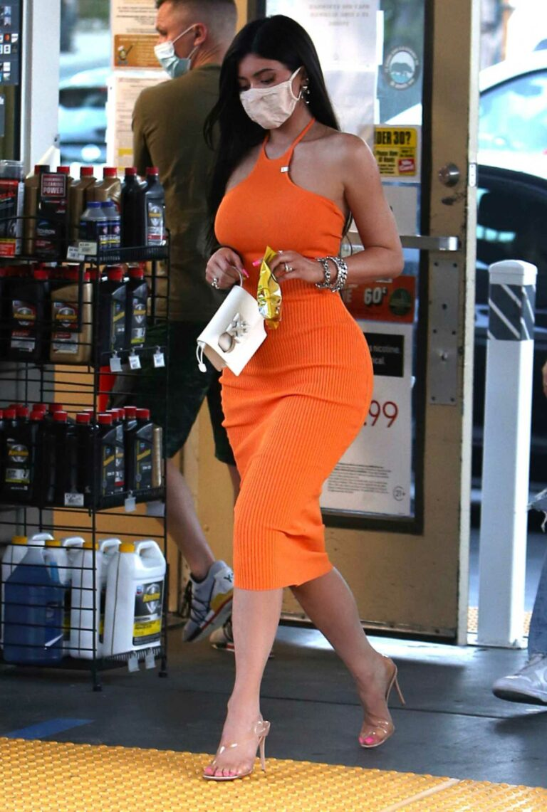 Kylie Jenner in an Orange Form Fitting Dress