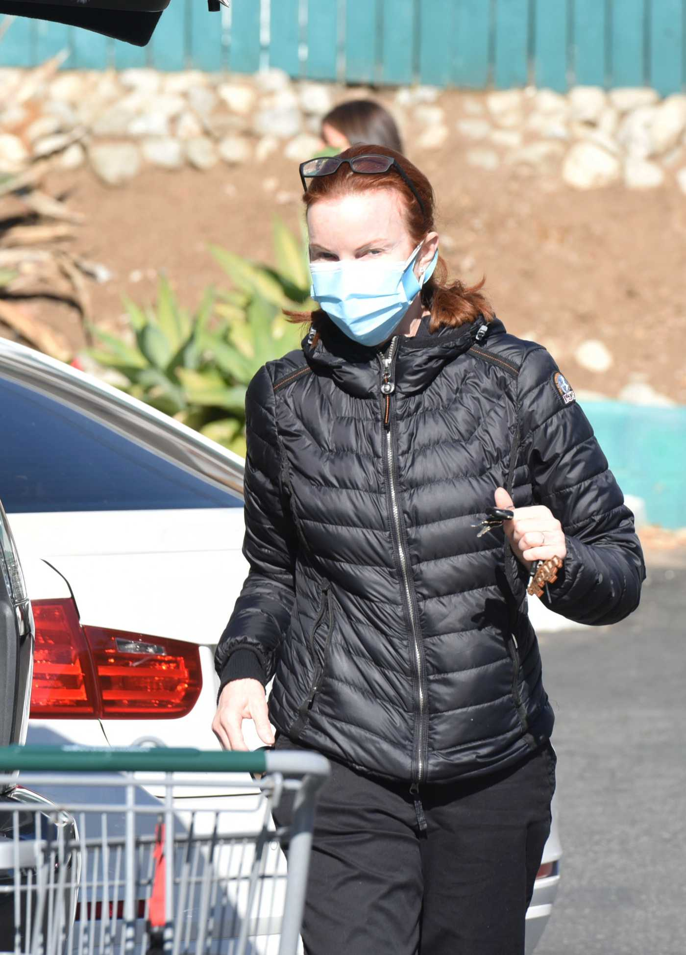 Marcia Cross in a Black Puffer Jacket Stops by Whole Foods for Groceries in Los Angeles 02/23/2021